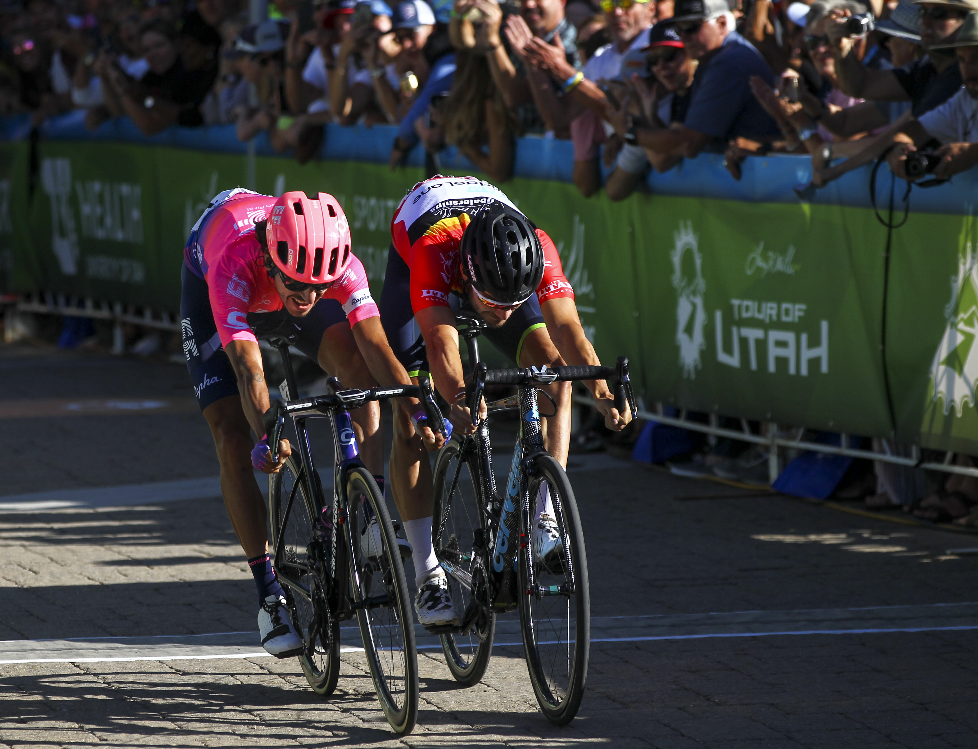 Lachlan Morton, left, just outstretches Hayden McCormick at the finish line of Stage 5 in the Tour of Utah at Canyons Village in Park City on Saturday, Aug. 17, 2019. Morton and McCormick were part of a breakaway group through most of the day.