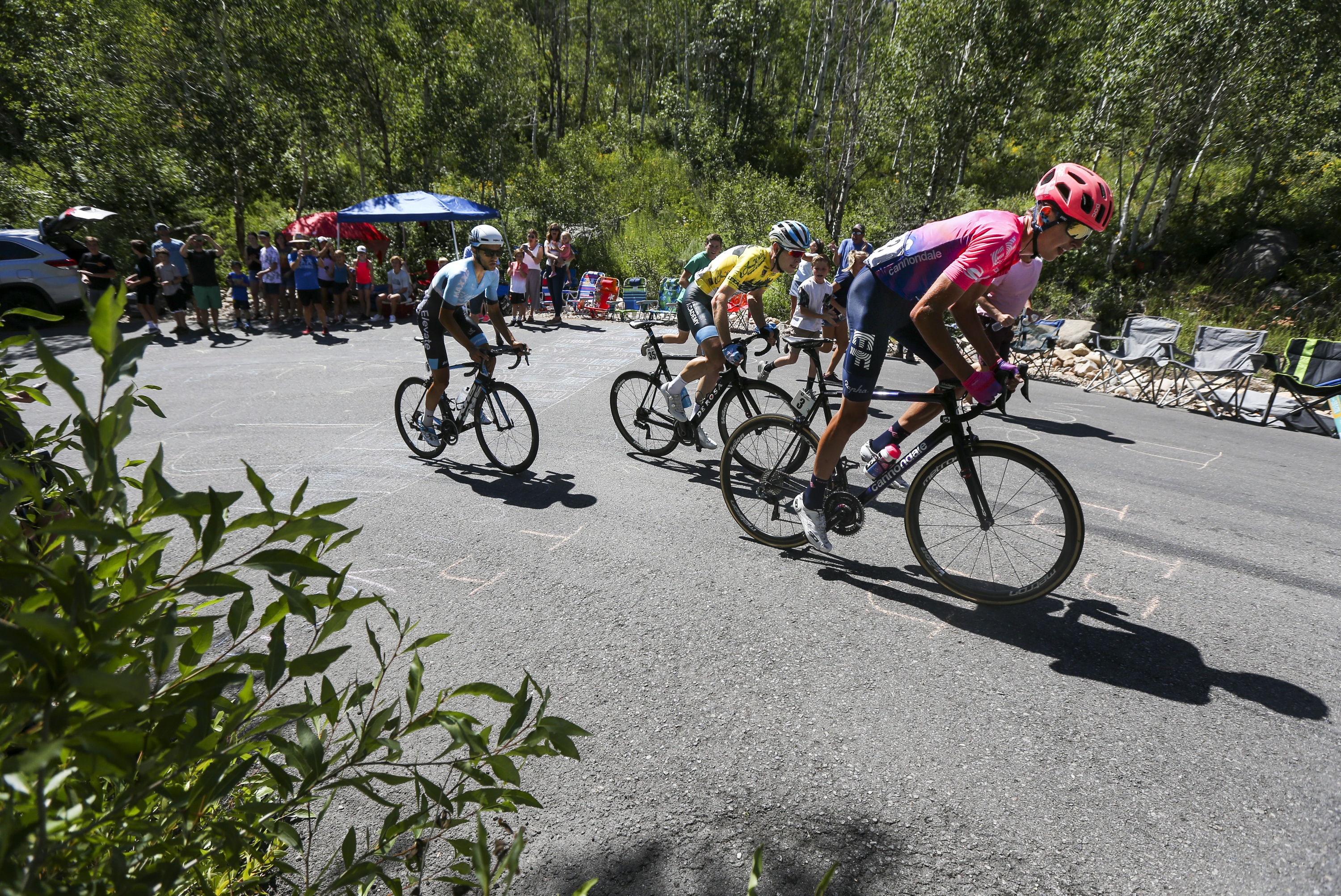 Cyclists James Piccoli, from left, Ben Hermans and Joseph Lloyd Dombrowski ascend Empire Pass during Stage 6 of the Tour of Utah in Wasatch Mountain State Park on Sunday, Aug. 18, 2019. Hermans won the general classification standings with a lead of 50 seconds.