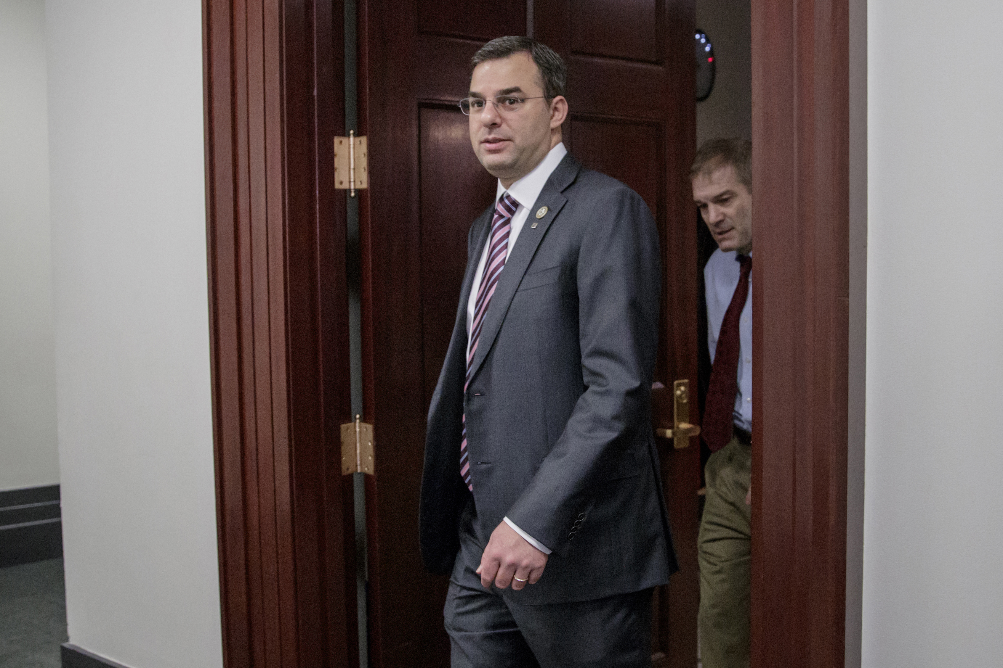 FILE - This March 28, 2017, file photo shows Rep. Justin Amash, R-Mich., followed by Rep. Jim Jordan, R-Ohio, leaving a closed-door strategy session on Capitol Hill in Washington. (AP Photo/J. Scott Applewhite, File)