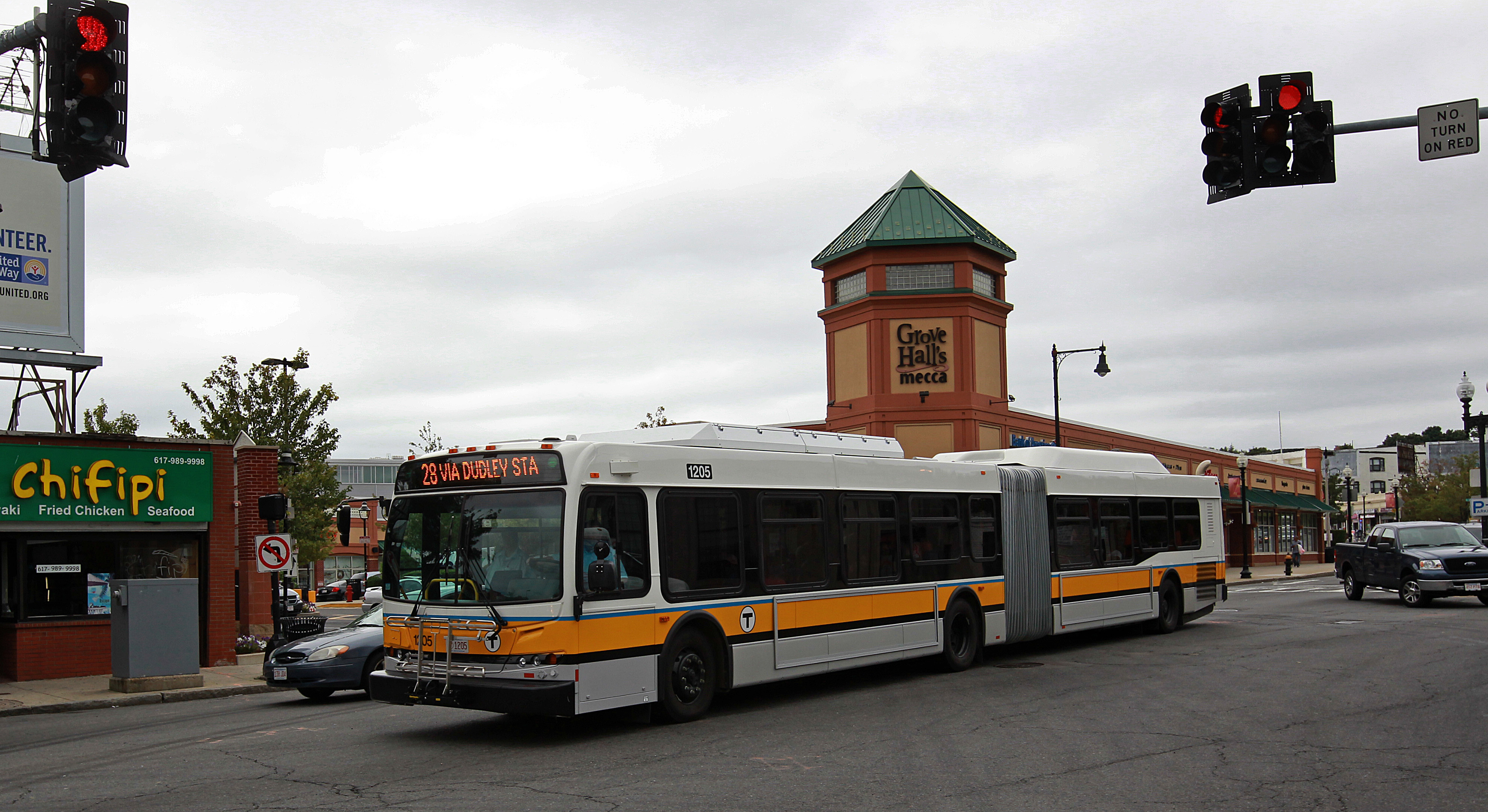 A bus runs along Boston's Blue Hill Avenue.