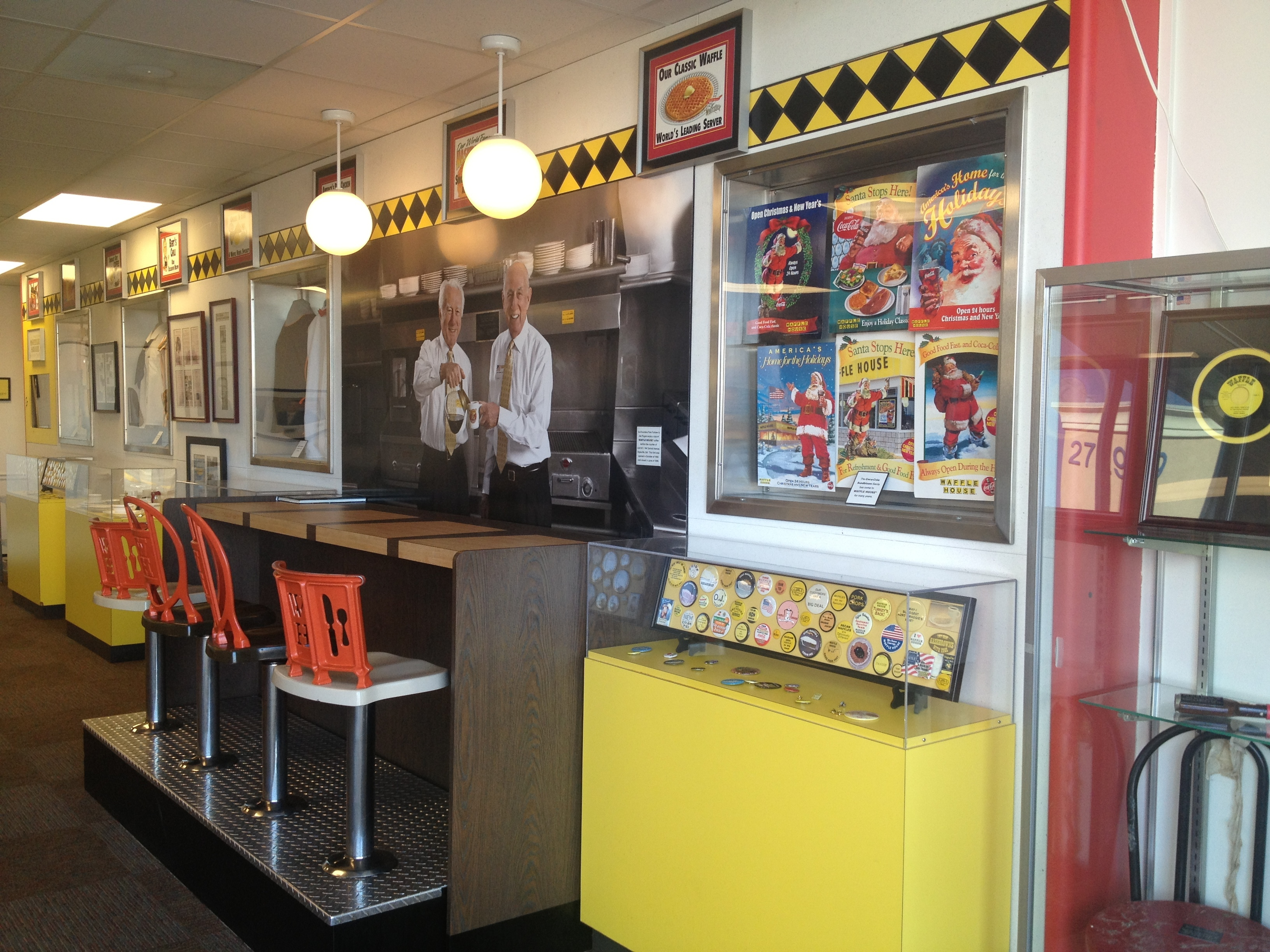A 1955-era Waffle House restaurant with bar seating and memorabilia displays.