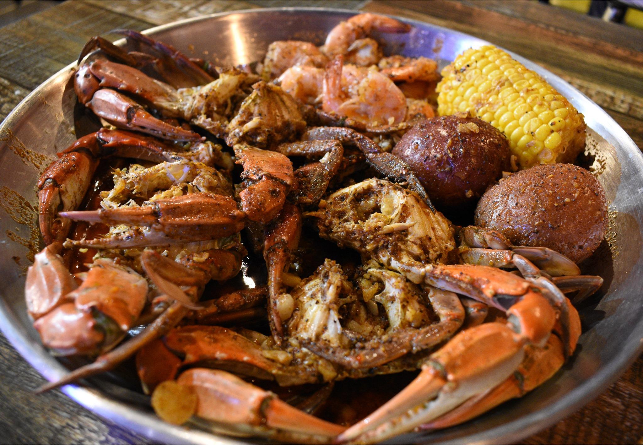 Boiled crab, potatoes, shrimp, and corn