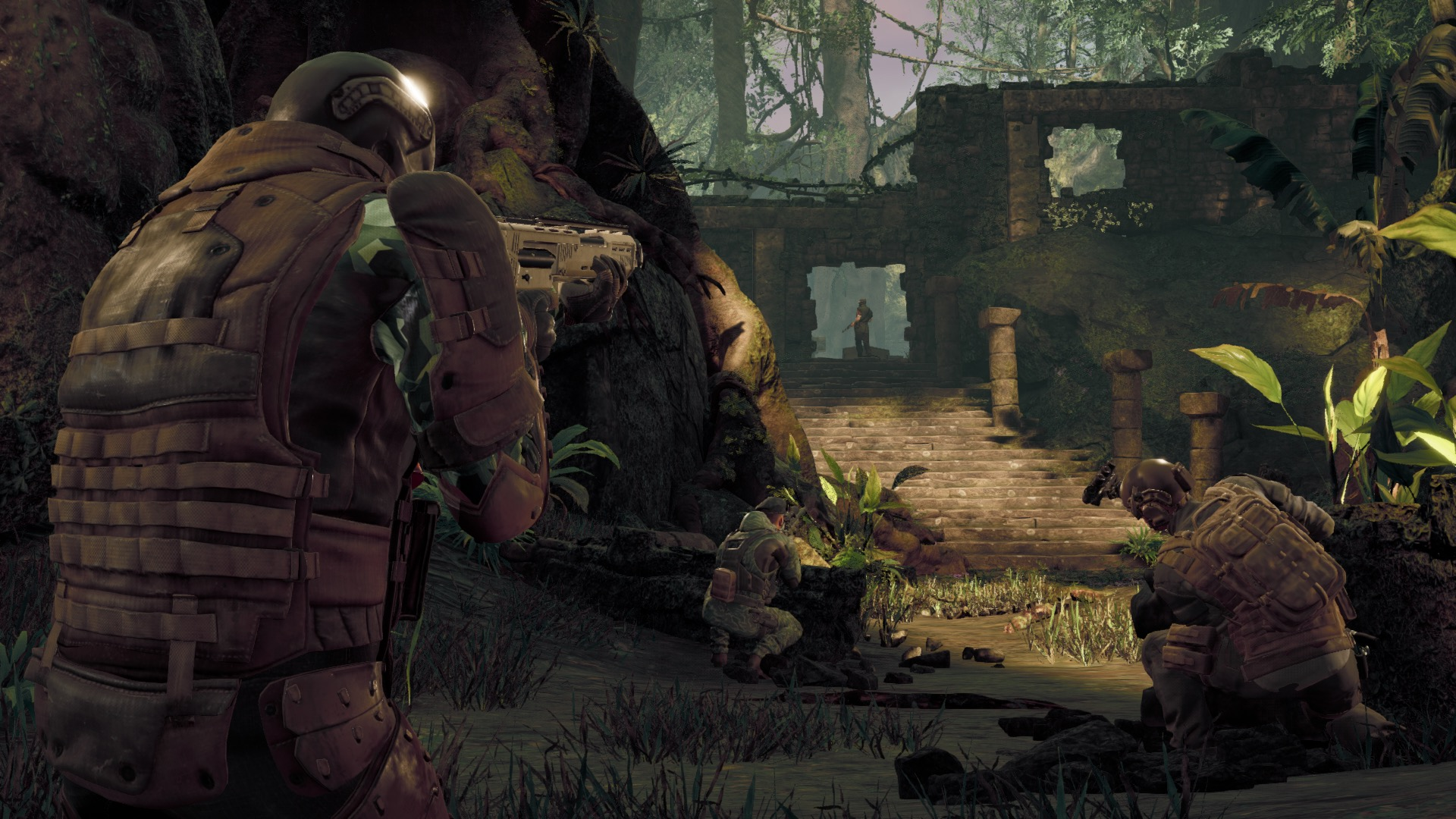 Soldiers aim their weapons at an enemy in the jungle