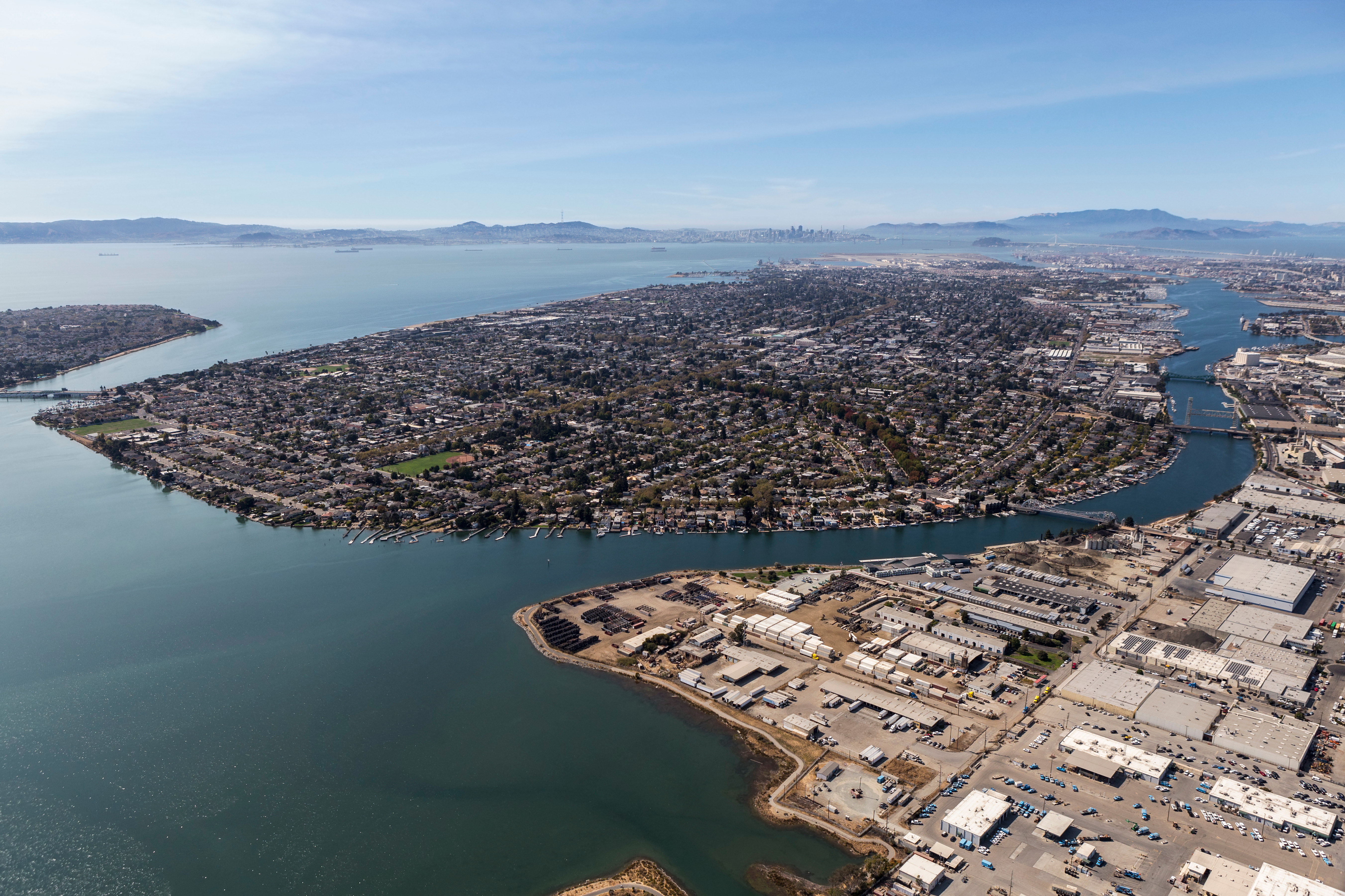 Aerial view of Alameda Island during a sunny day, with Oakland to the right.