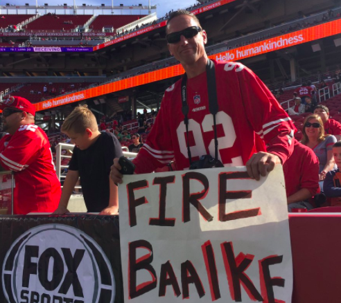 "San Francisco 49ers fan with a ""Fire Trent"" Baalke sign"