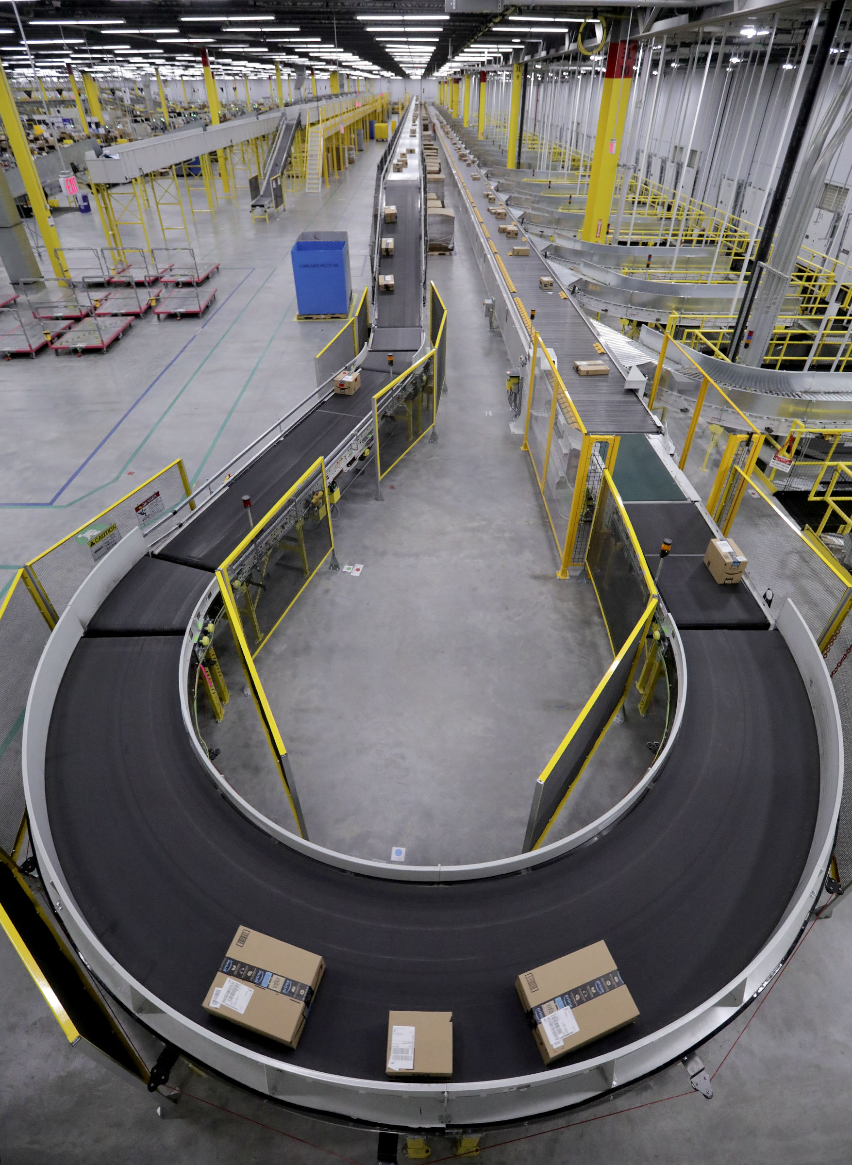 Boxes move through the new Amazon Fulfillment Center in Salt Lake City on Wednesday, April 17, 2019.