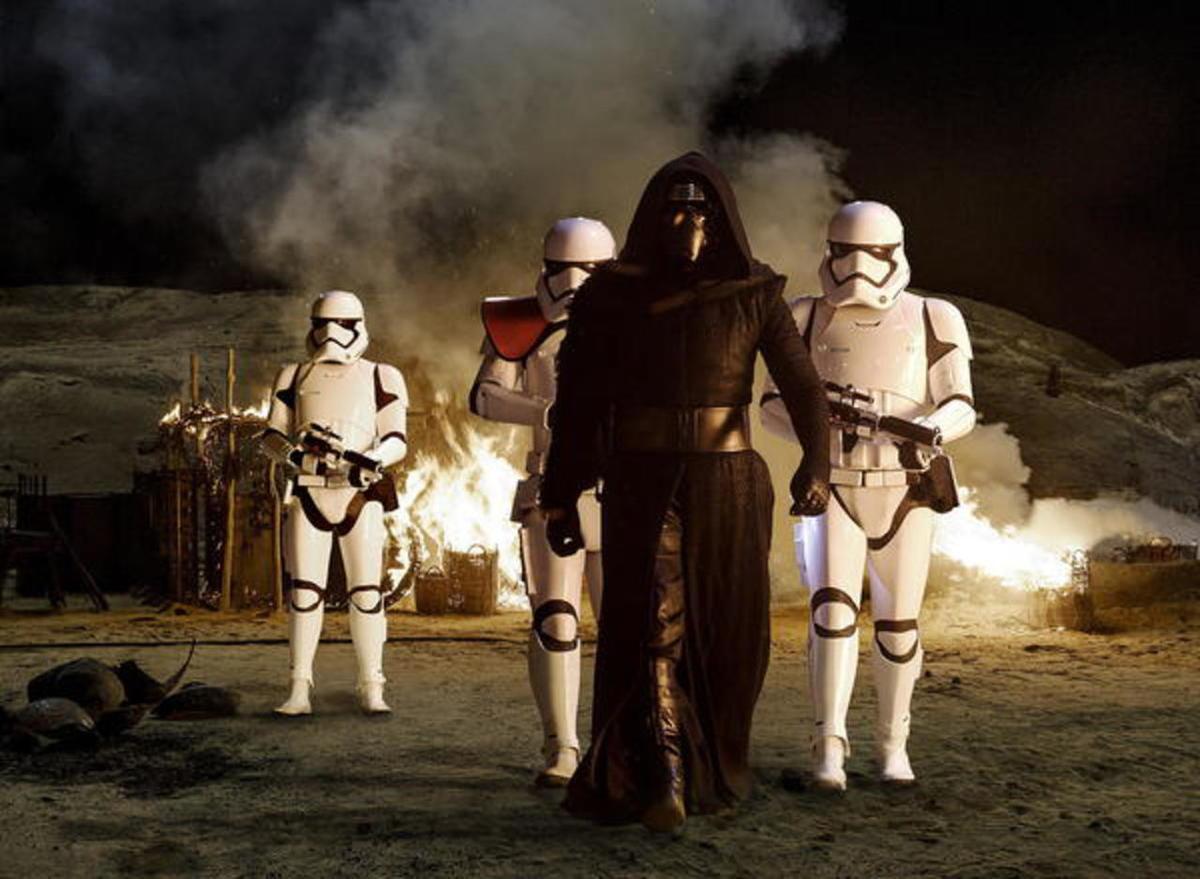 "Kylo Ren (Adam Driver) with Stormtroopers in ""Star Wars: The Force Awakens."""