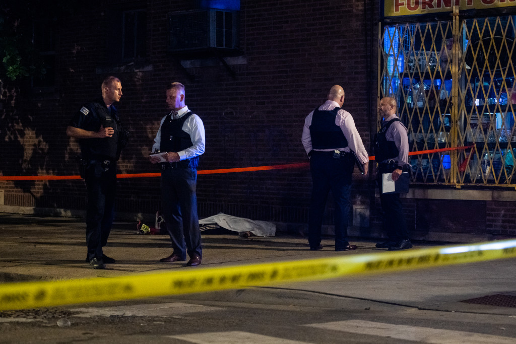 Chicago police investigate the scene of a fatal shooting in Chicago Lawn on the South Side.