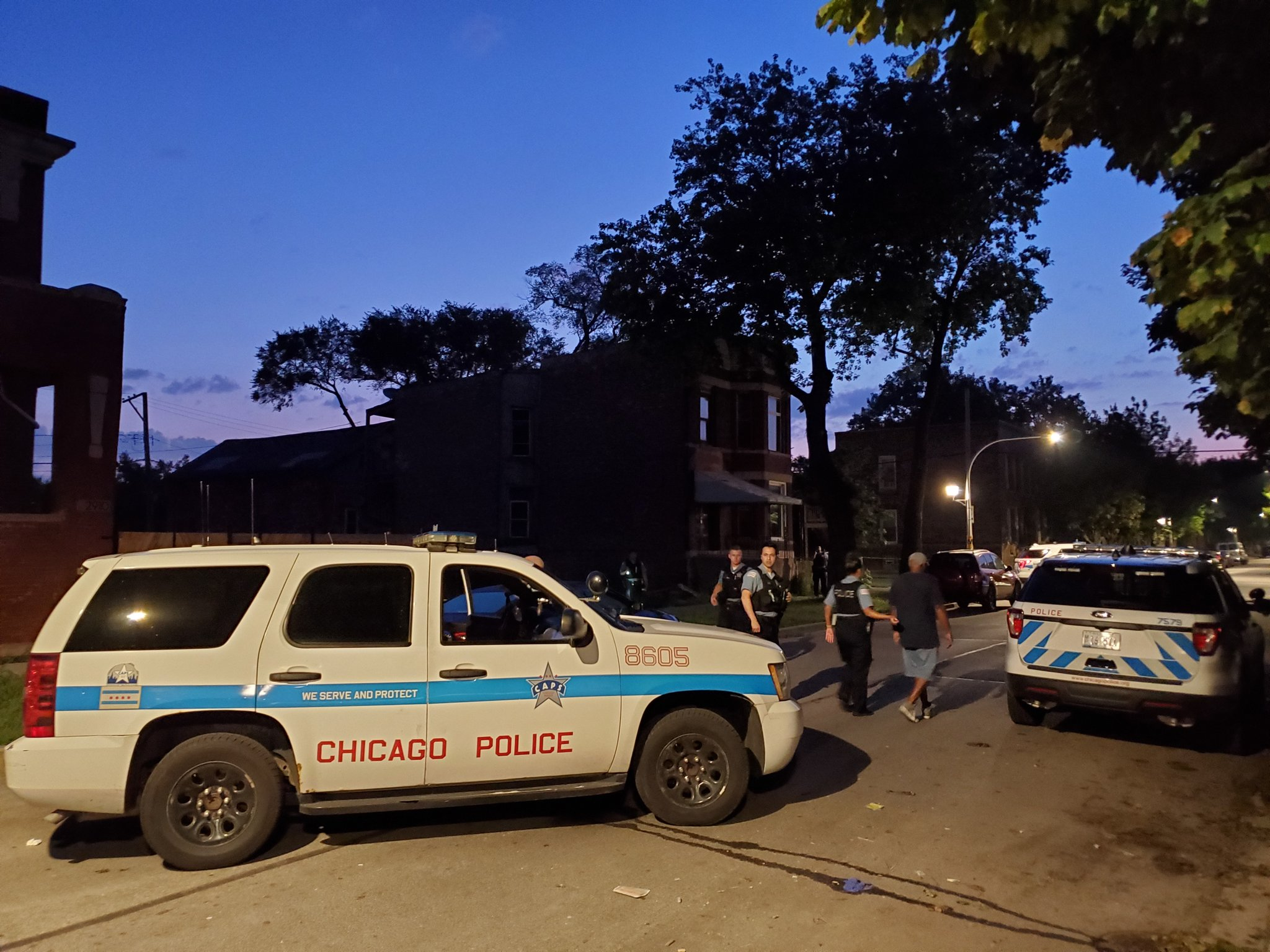 Police investigate the scene of a shooting in East Garfield Park on the West Side.