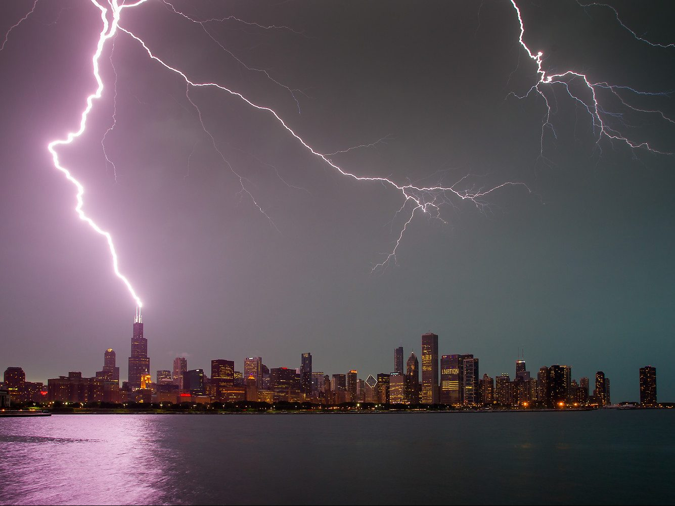 Lightning strikes the Willis Tower following a severe thunderstorm as seen from Solidarity Drive, Monday, June 30, 2014. | Guy Rhodes/For Sun-Times Media