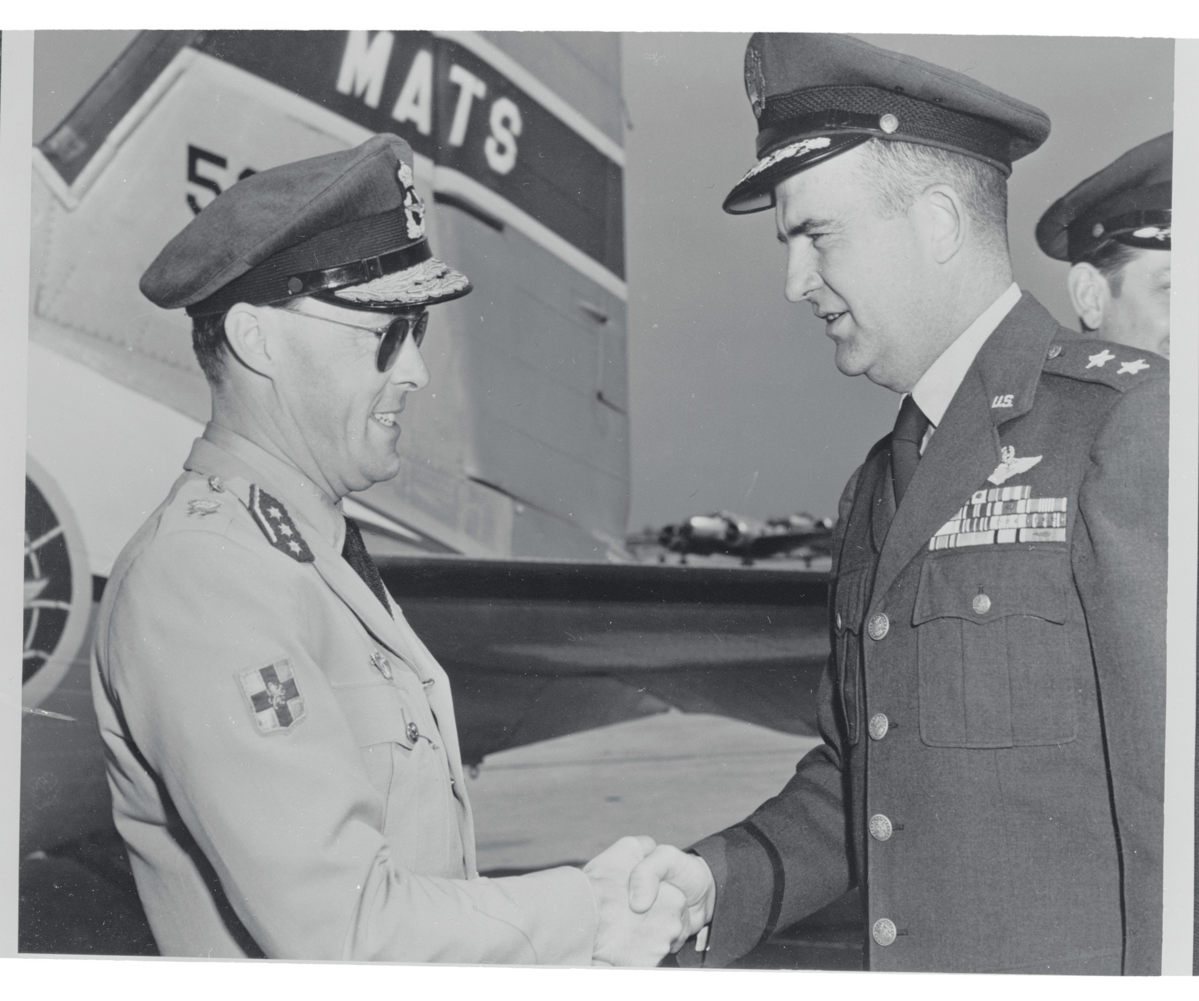"""<p zoompage-fontsize=""""15"""" style="""""""">Prince Bernhard Shaking Hands with Dean C. Strother"""