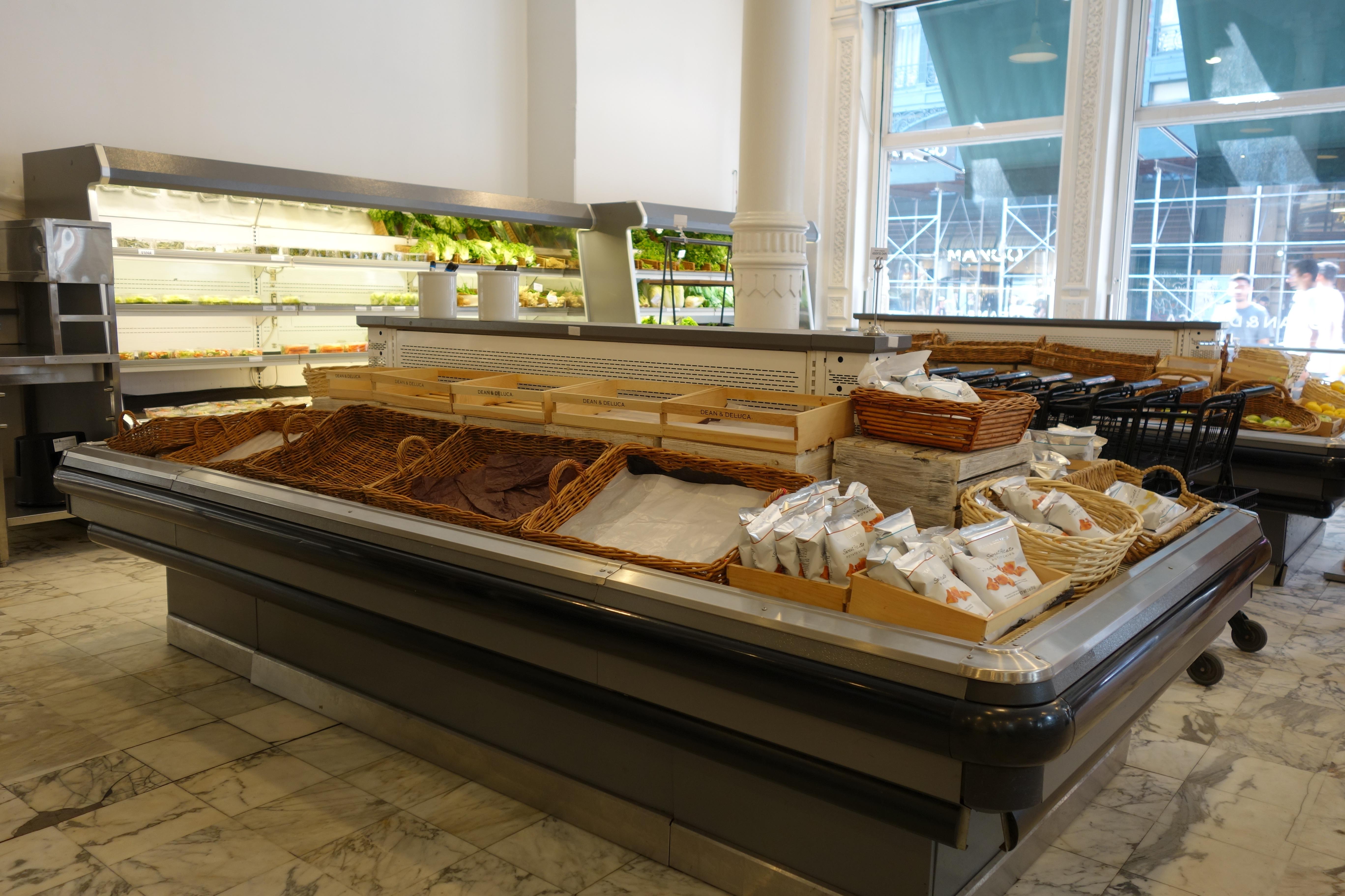 Empty produce bins inside the Dean & DeLuca grocery store