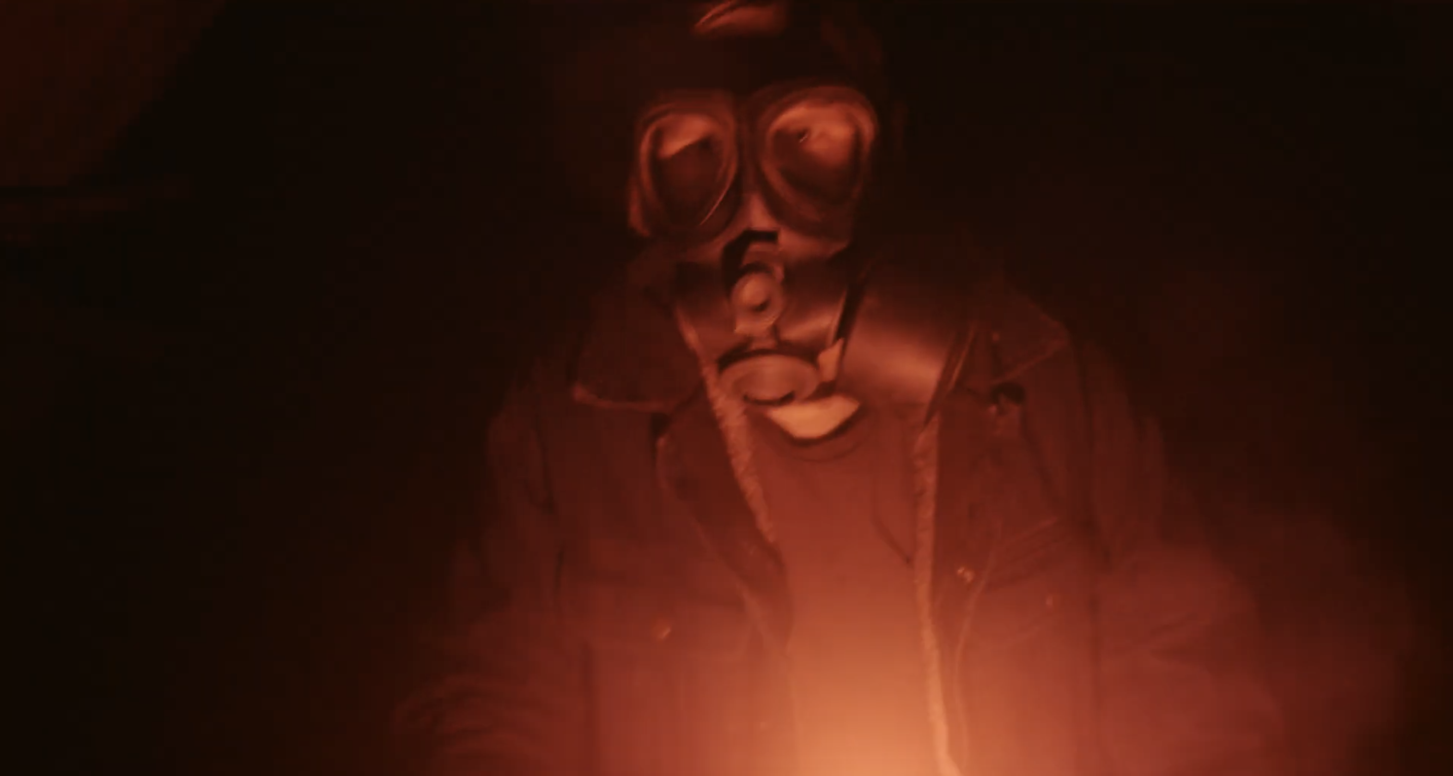 a figure wearing a gas mask, lit only by the red glow of a flare, in a darkened hallway