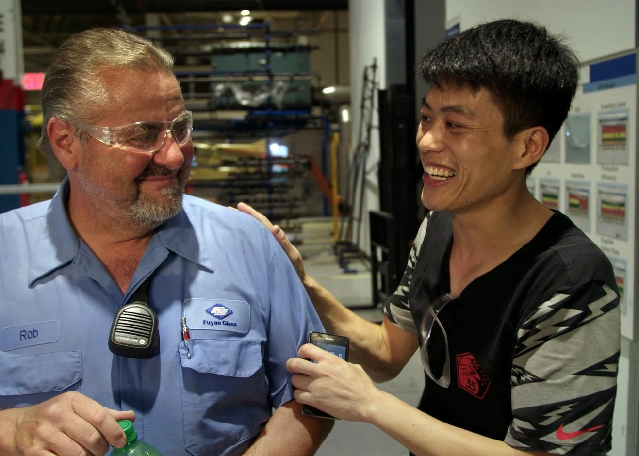 An American worker and a Chinese worker in Dayton, Ohio in the documentary American Factory.
