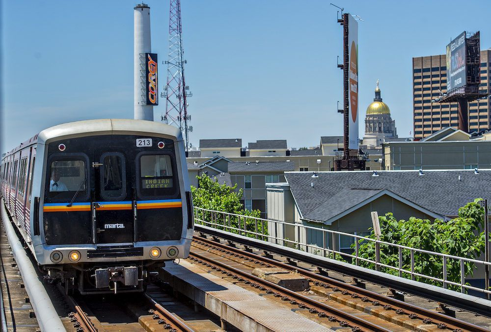 A Marta train is shown with Georgia's Gold Dome at right and the rest of downtown.