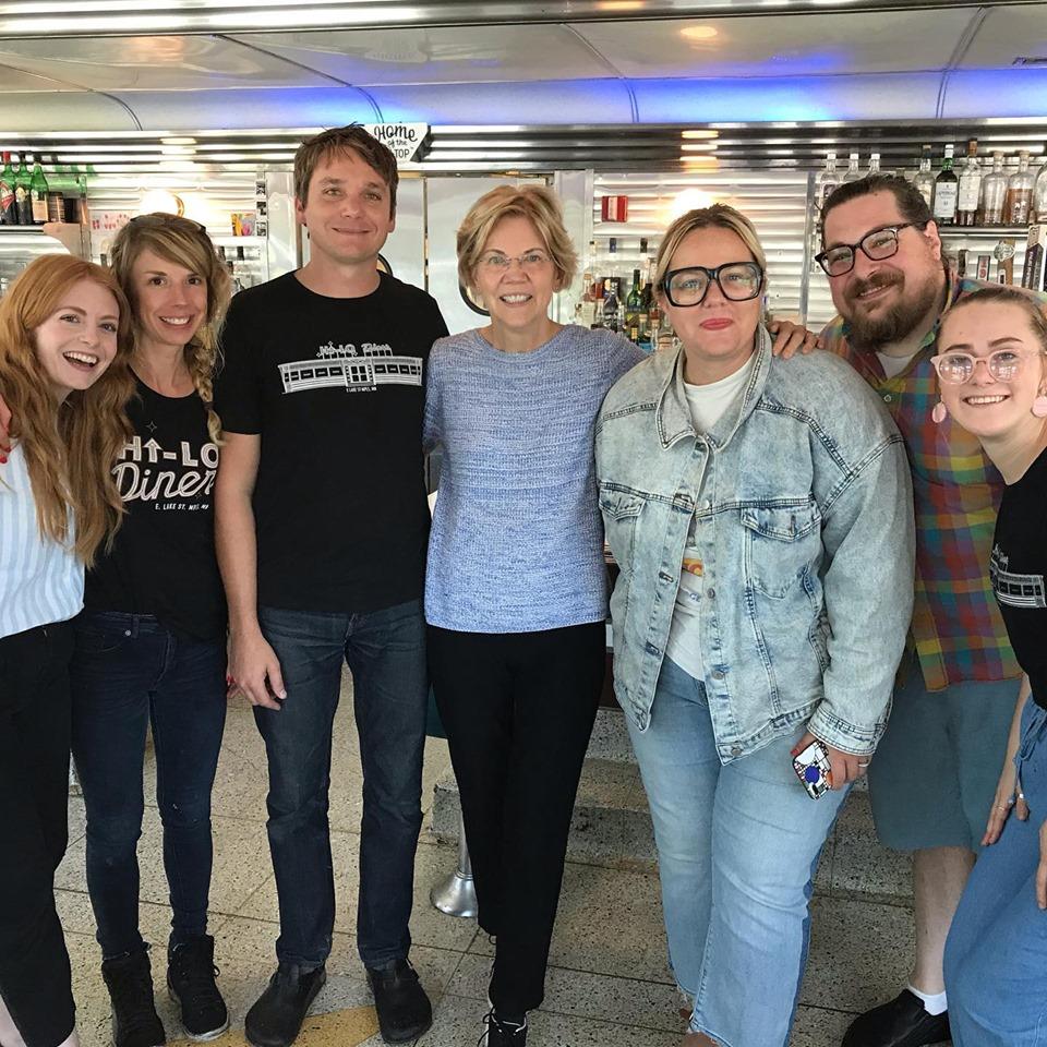 Senator Elizabeth Warren stands with six staff members at Minneapolis' Hi-Lo Diner.