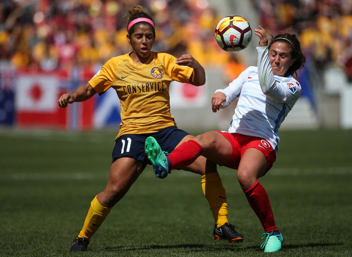 Utah Royals FC midfielder Desiree Scott (11) and Chicago Red Stars midfielder Alyssa Mautz (4) compete for the ball at Rio Tinto Stadium in Sandy on Saturday, April 14, 2018.