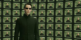 """Keanu Reeves in """"The Matrix Reloaded."""" """"Matrix"""" films balance spectacular and human elements."""
