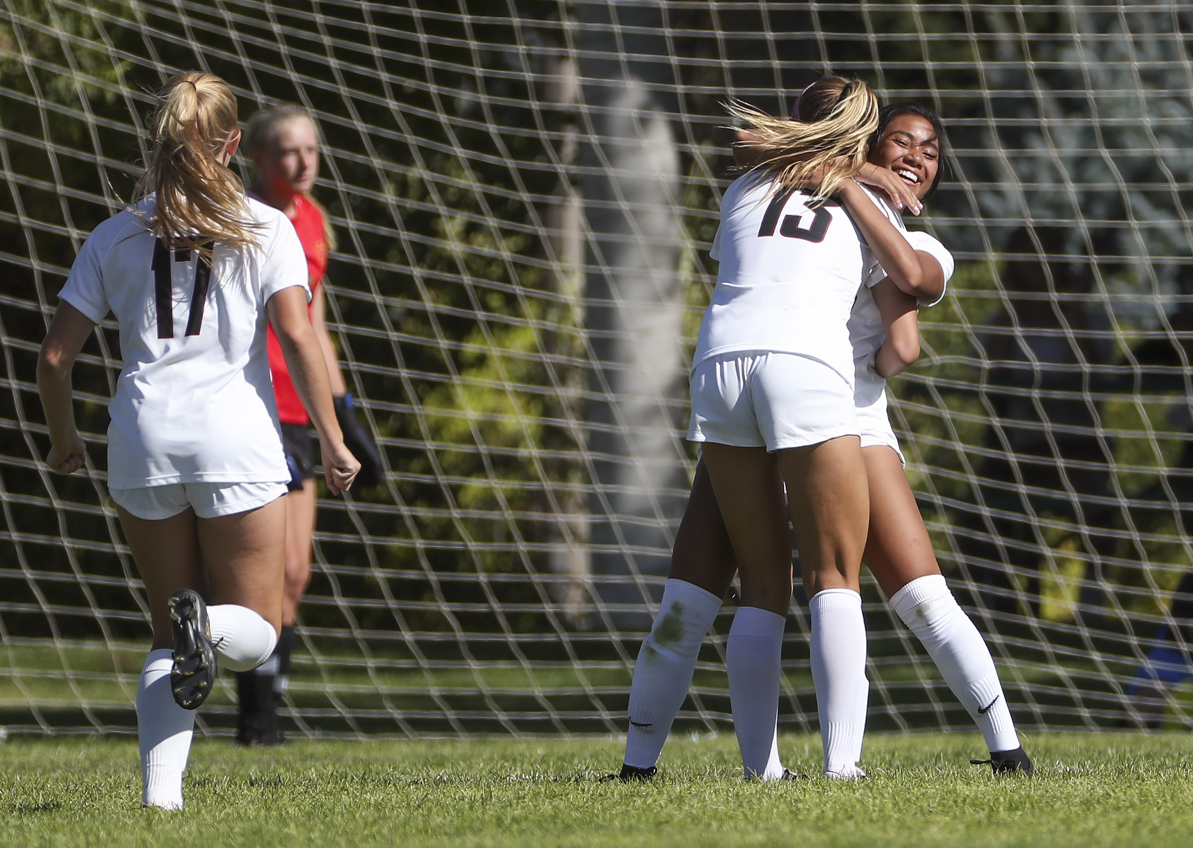 Tiani Fonoti, right gets a hug from Northridge teammate Lauren Call after scoring the only goal of the game as Northridge defeated Davis 1-0 in Kaysville on Tuesday, Aug. 20, 2019.