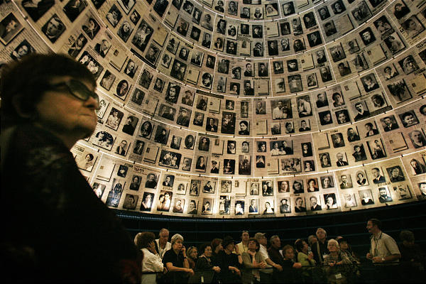 A group of Holocaust survivors and their relatives visit the Yad Vashem Holocaust Memorial during conference in Jerusalem.