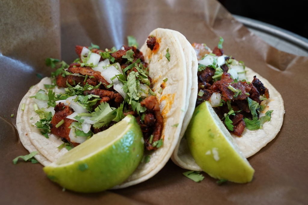 Al pastor tacos made at Los Takitos Taco Shop