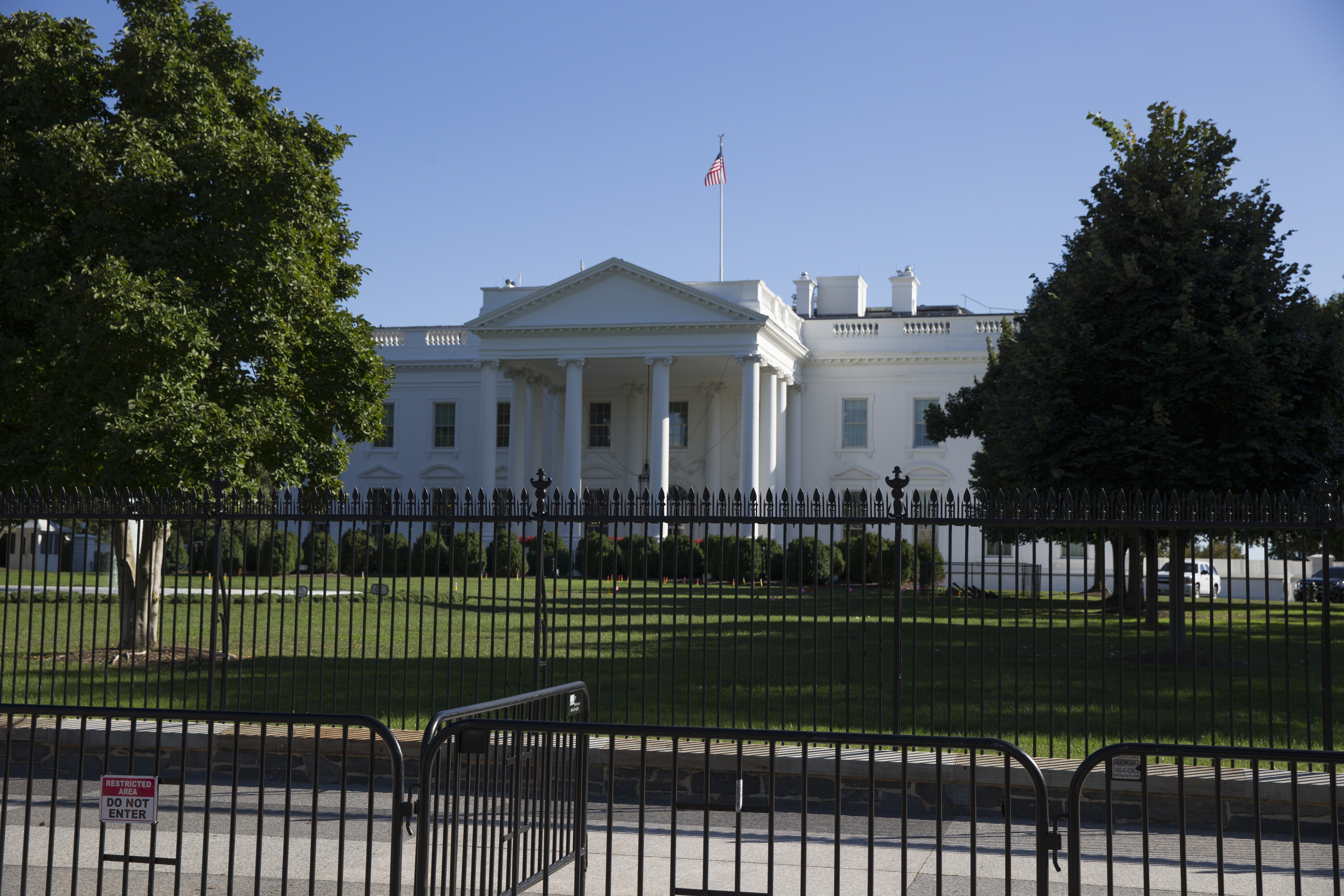 The Pennsylvania Avenue NW of the White House, with a security perimeter and its historic fence.