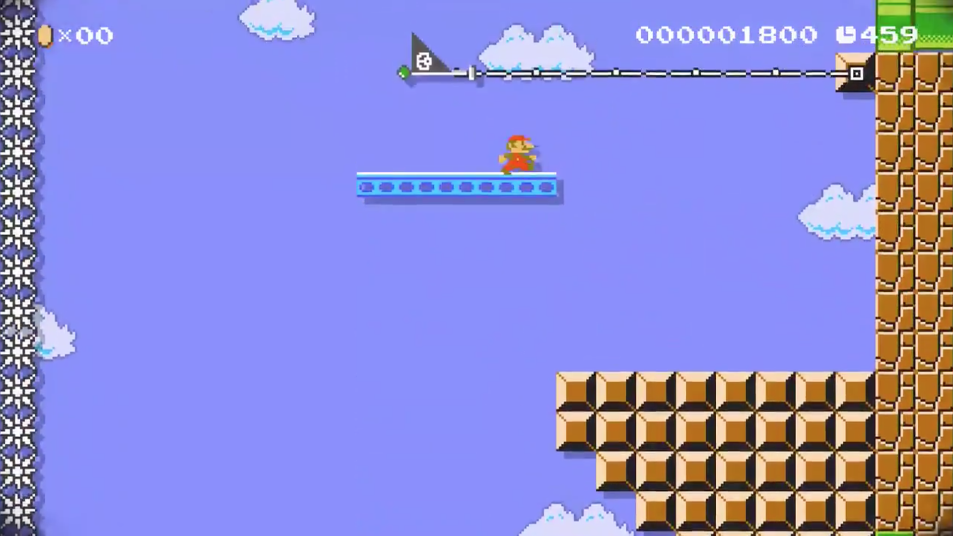 Screenshot of a Super Mario Maker 2 stage showing World 1-1 of Super Mario Bros. on its side.