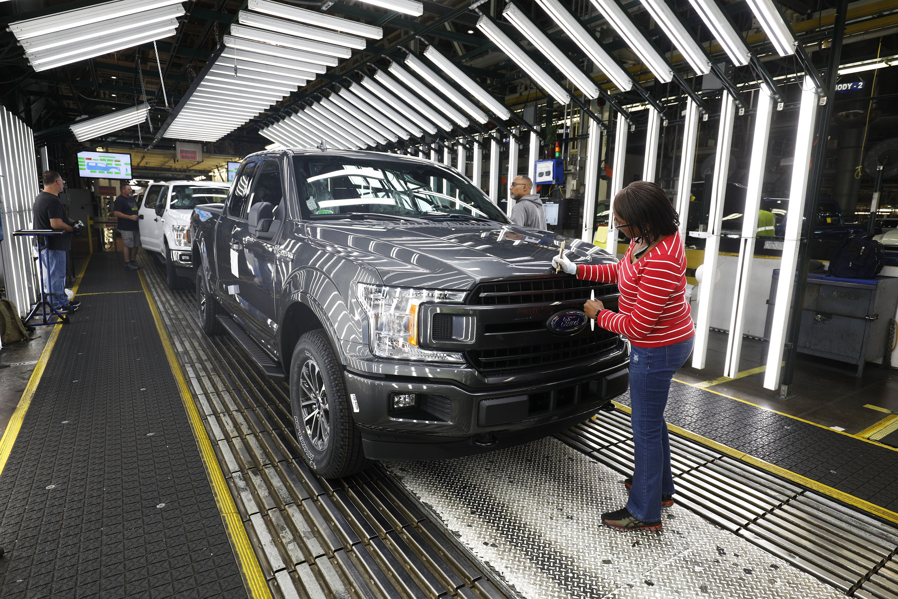 Ford F150 trucks go through the customer acceptance line at the Ford Dearborn Truck Plant on September 27, 2018 in Dearborn, Michigan.