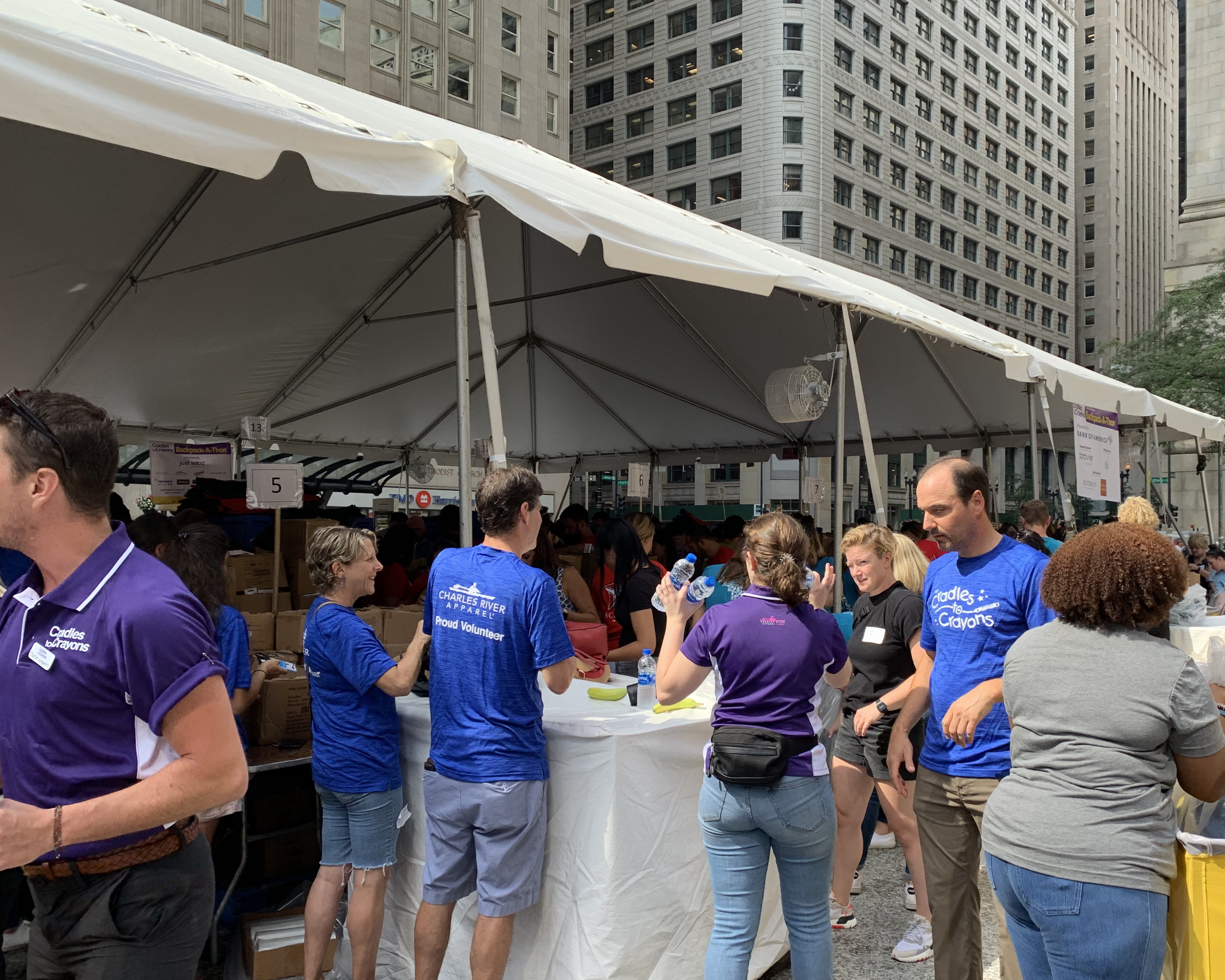 Volunteers participate in the fourth annual Backpack-a-Thon, organized by Cradles to Crayons and in partnership with Bank of America, the company with the greatest volunteer turnout.