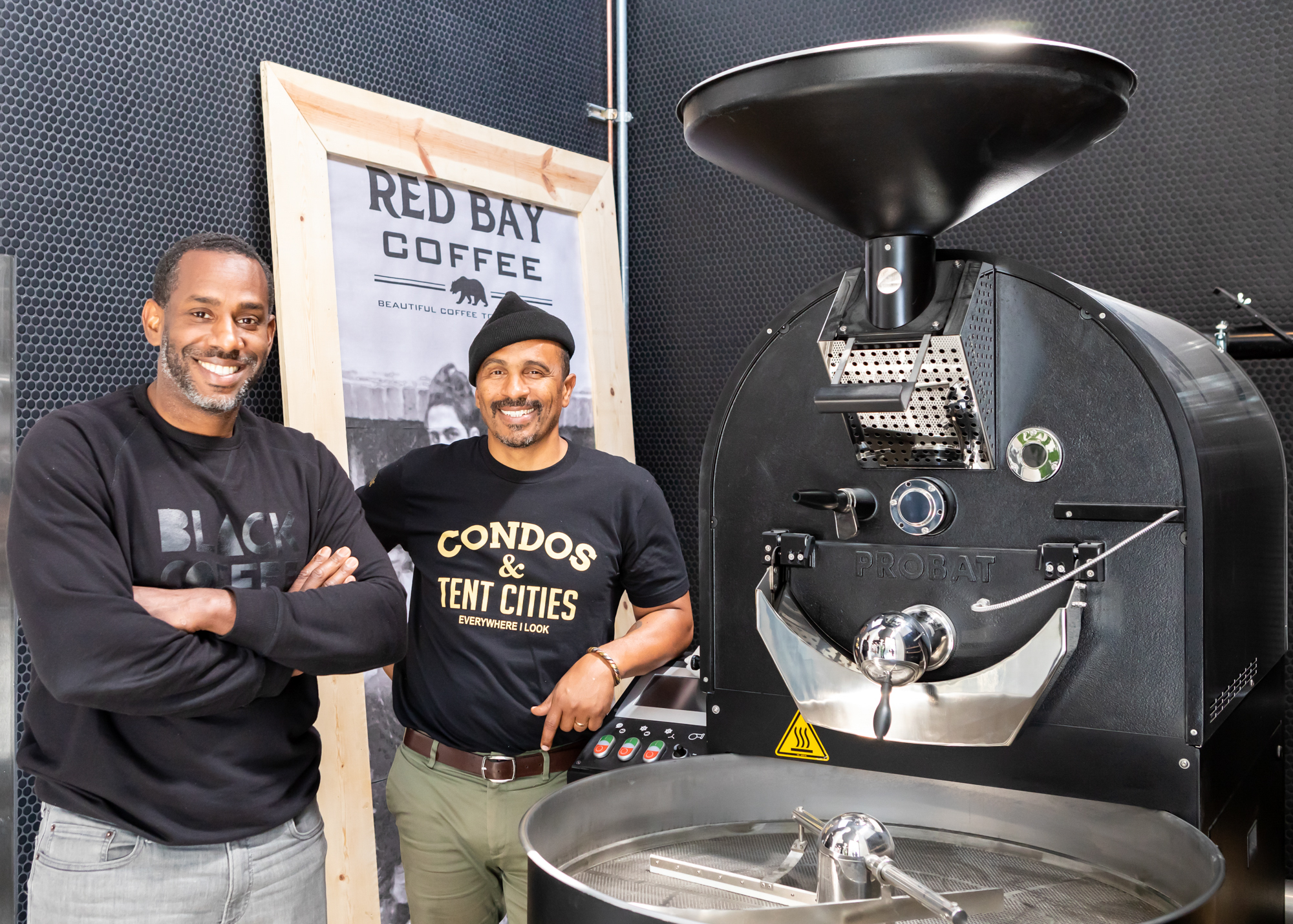 Left, Tijan Watt. with Red Bay Coffee Founder Keba Konte, right, in front of a roaster
