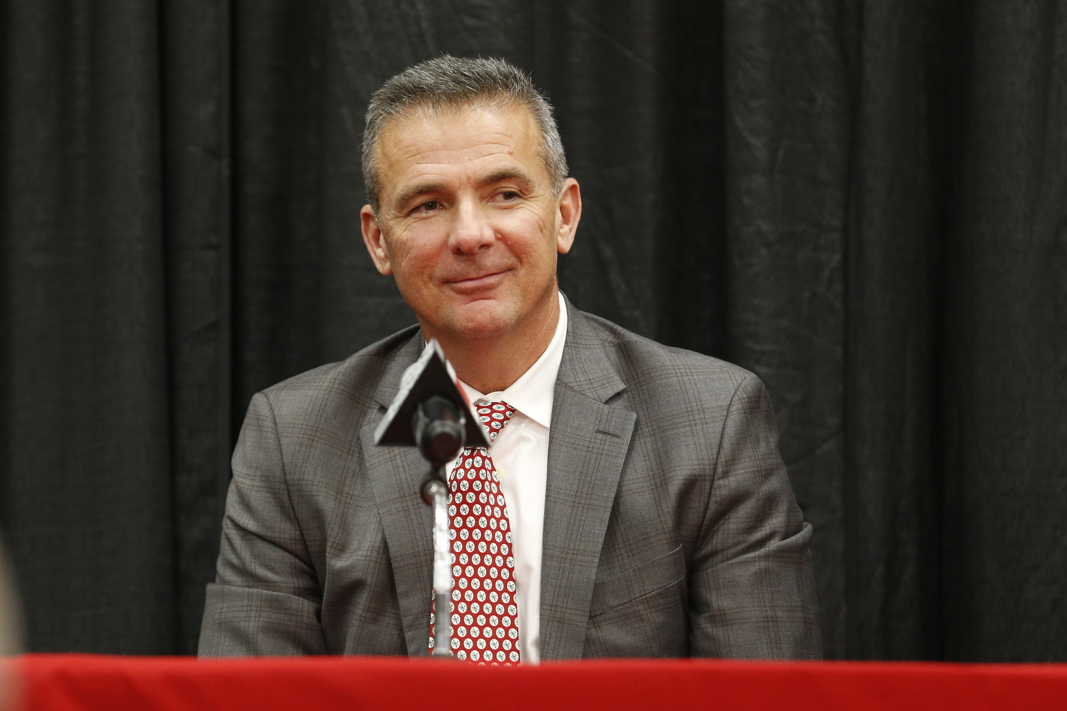Ohio State head football coach Urban Meyer answers questions during a news conference announcing his retirement and the hiring of Ryan Day as his replacement Tuesday, Dec. 4, 2018, in Columbus, Ohio. (AP Photo/Jay LaPrete)