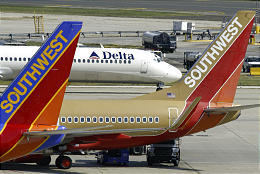 Southwest Airlines jetliners sit at Philadelphia International. Southwest bid Friday for ATA Airlines gates in Chicago.