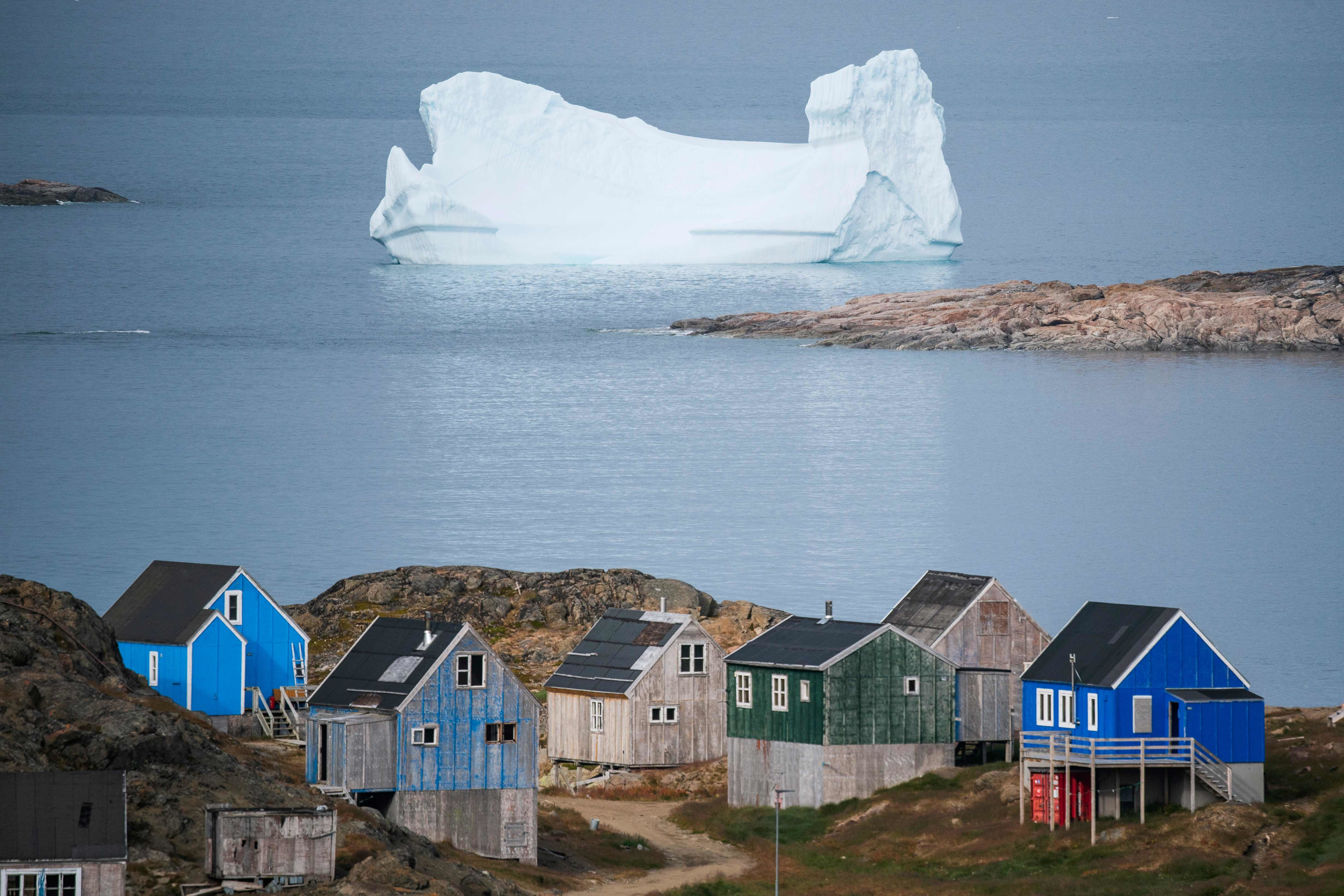 Icebergs float behind the town of Kulusuk in Greenland.