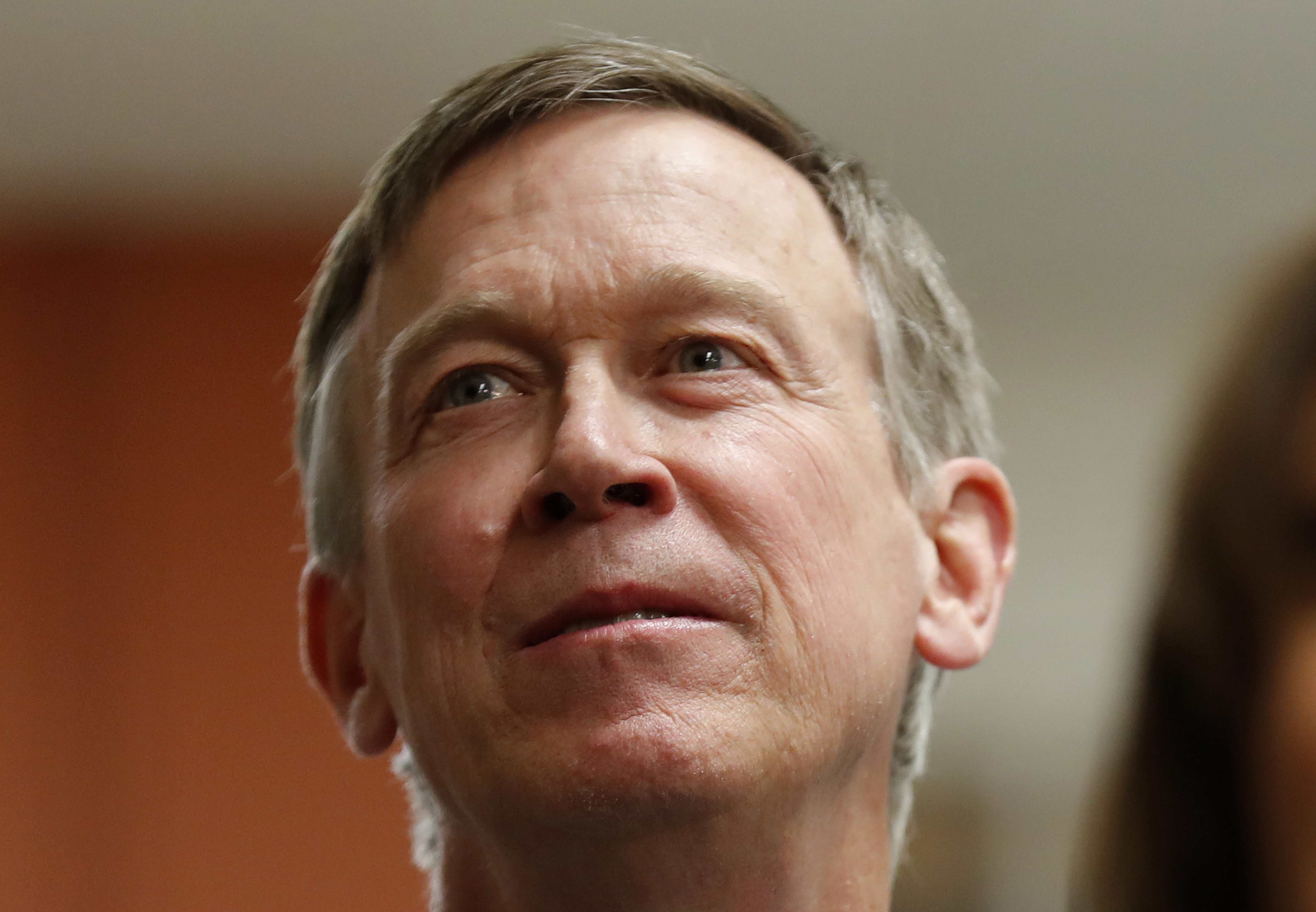 FILE - In this Feb. 23, 2019, file photo, former Colorado Gov. John Hickenlooper, left, waits to speak at the Story County Democrats' annual soup supper fundraiser in Ames, Iowa. Hickenlooper is running for president, becoming the second governor to jump
