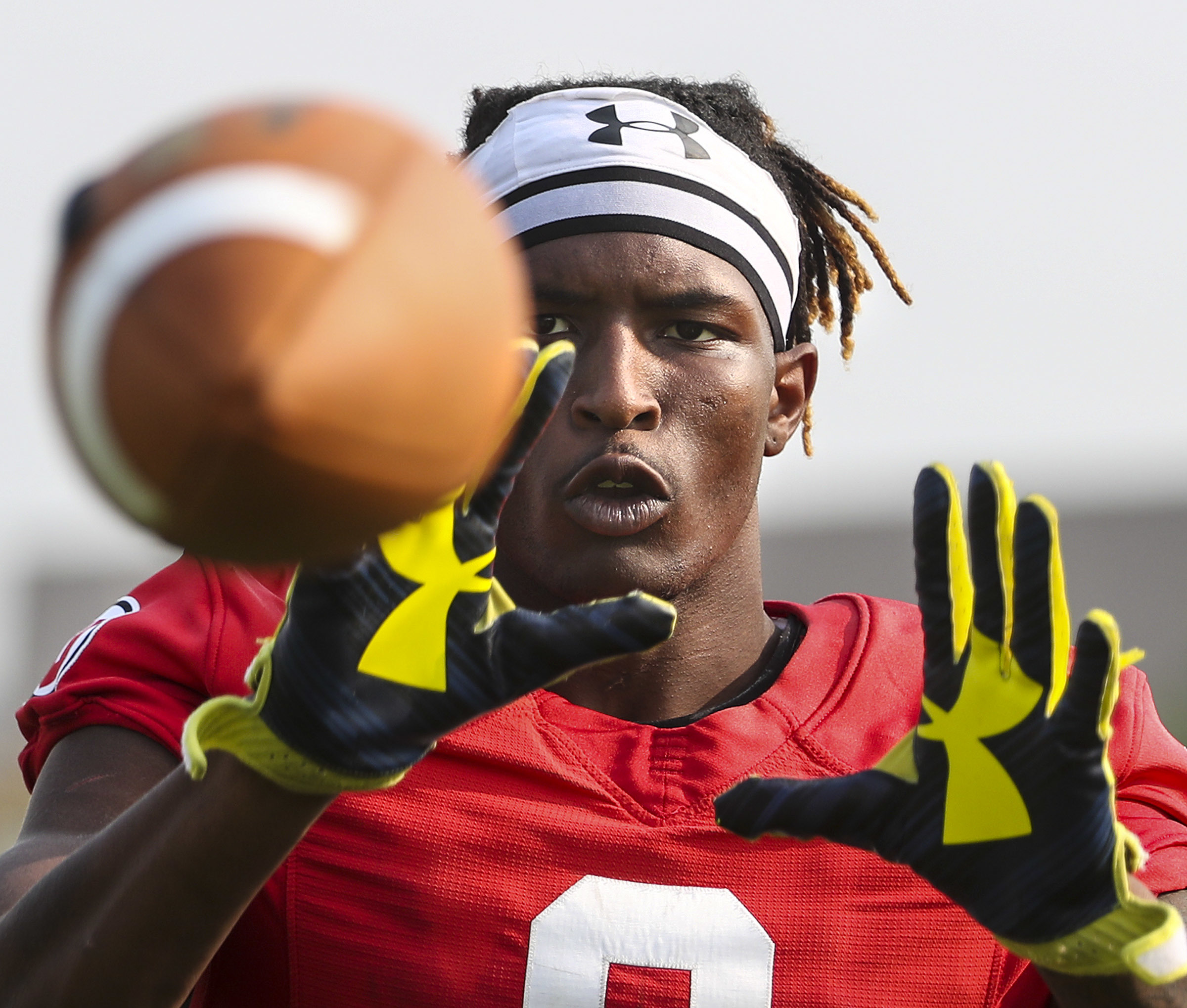 Utah receiver Siaosi Mariner catches balls thrown at him from a JUGS machine following on Thursday, Aug. 23, 2018. Mariner transferred to Utah State.