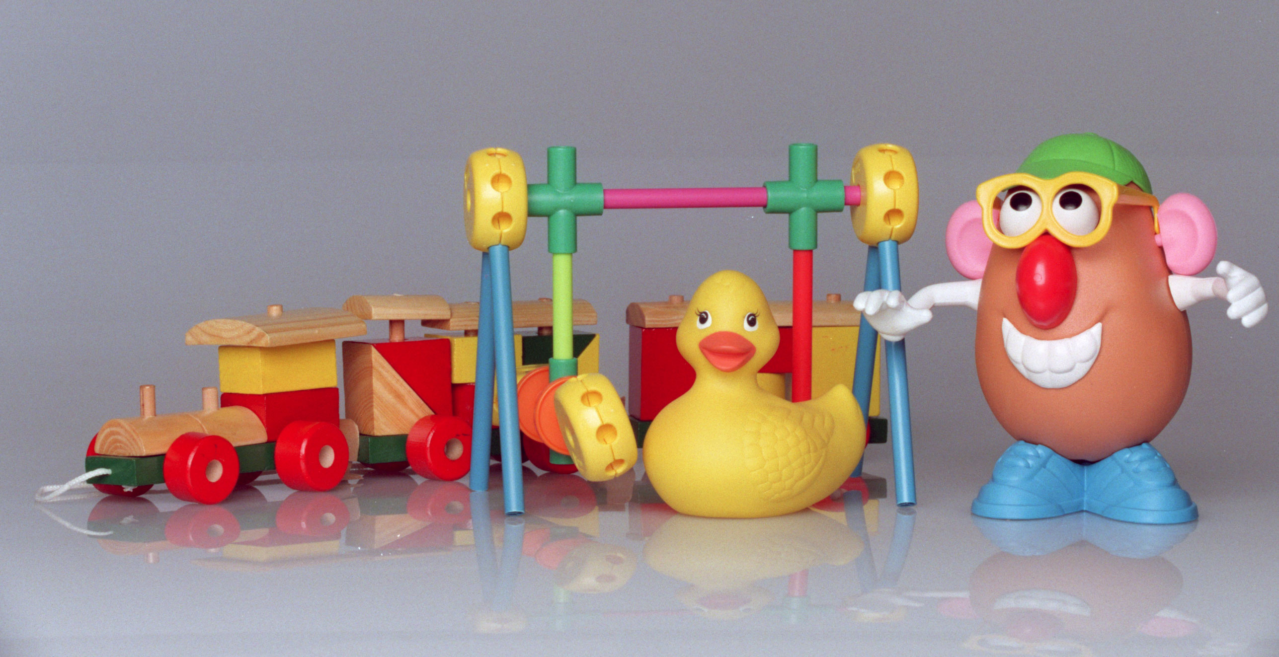 Wooden train, tinker toys, rubber ducky, and Mr. Potato Head