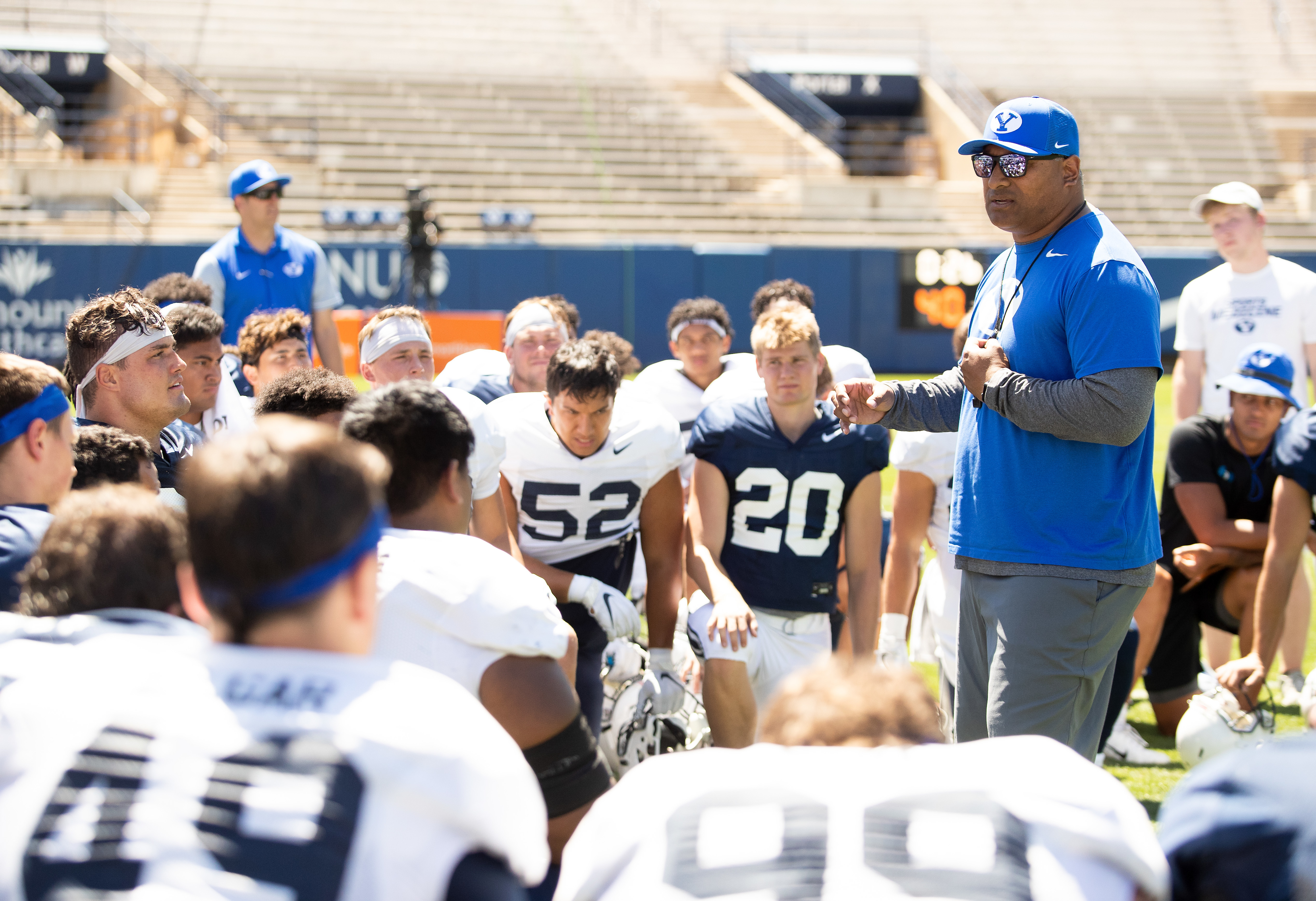 BYU coach Kalani Sitake talks to the team during the Cougars' practice Wednesday, Aug. 21, 2019 at LaVell Edwards Stadium in Provo.