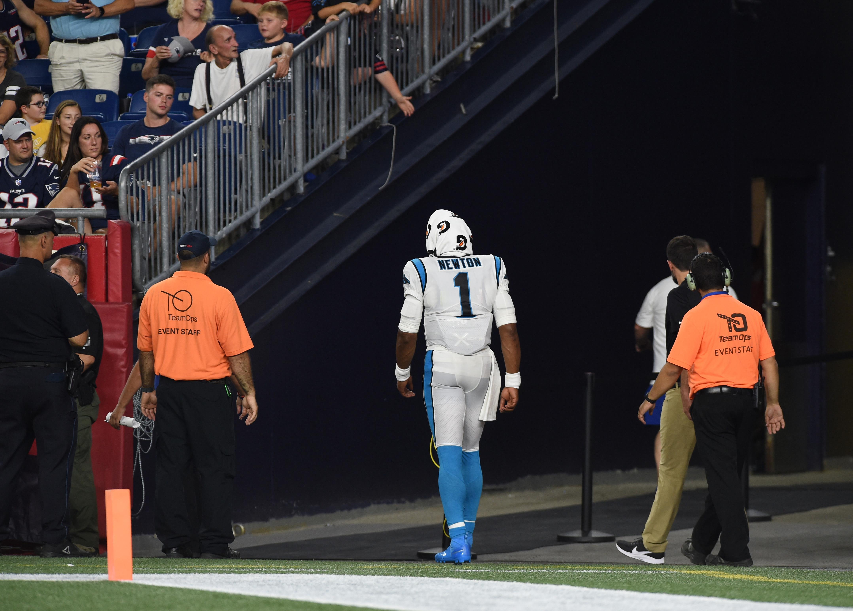 Carolina Panthers QB Cam Newton walks to the locker room against the New England Patriots, Aug. 22, 2019.