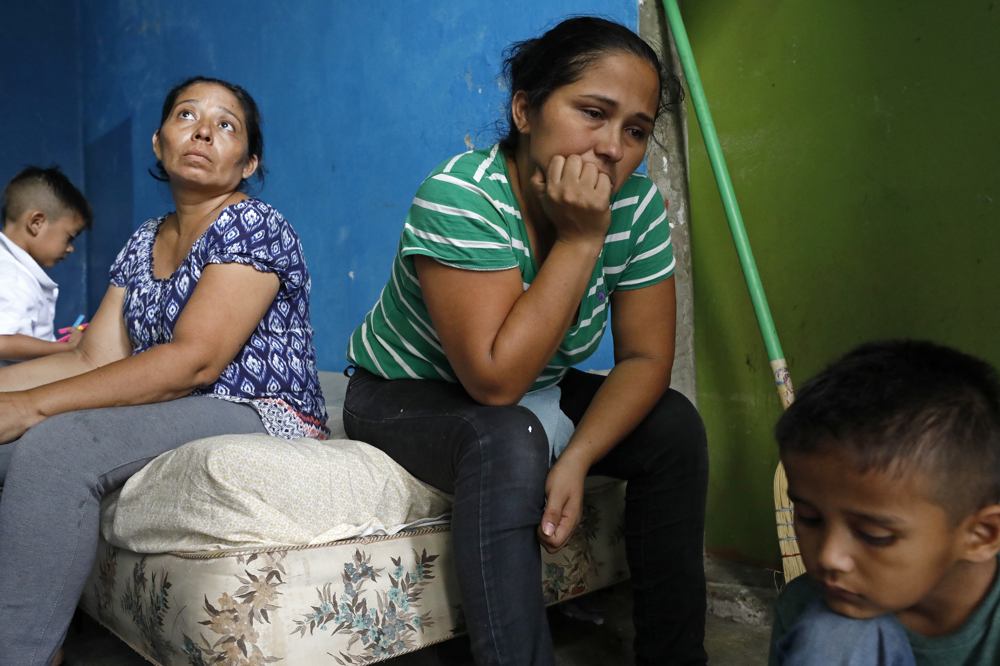 Honduran migrant Mirna Leyva Quintanilla, 32 (center) her son Steven, 6, (right) and other Honduran migrants in the Nuevo Laredo city government shelter, Wednesday Aug. 21, 2019, in Nuevo Laredo, Tamaulipas, Mexico. The migrants were sent back to Mexico under the Migrant Protection Protocols.