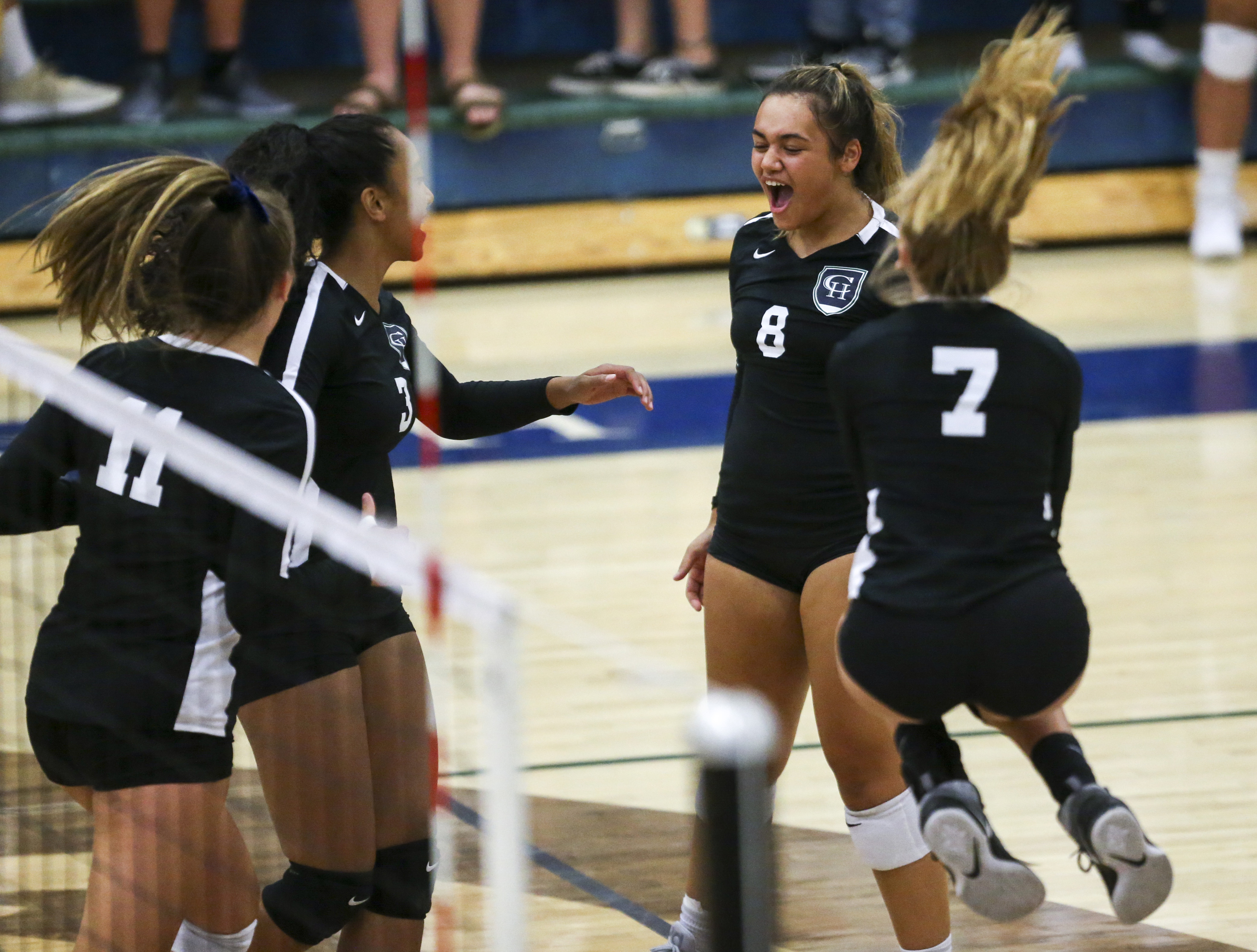 Copper Hills' Teniyah Leuluai (8) celebrates with her teammates after they score a point in the second set during a match against Springville High School at Copper Hills High School in West Jordan on Thursday, Aug. 22, 2019. Copper Hills won the match in three straight sets.