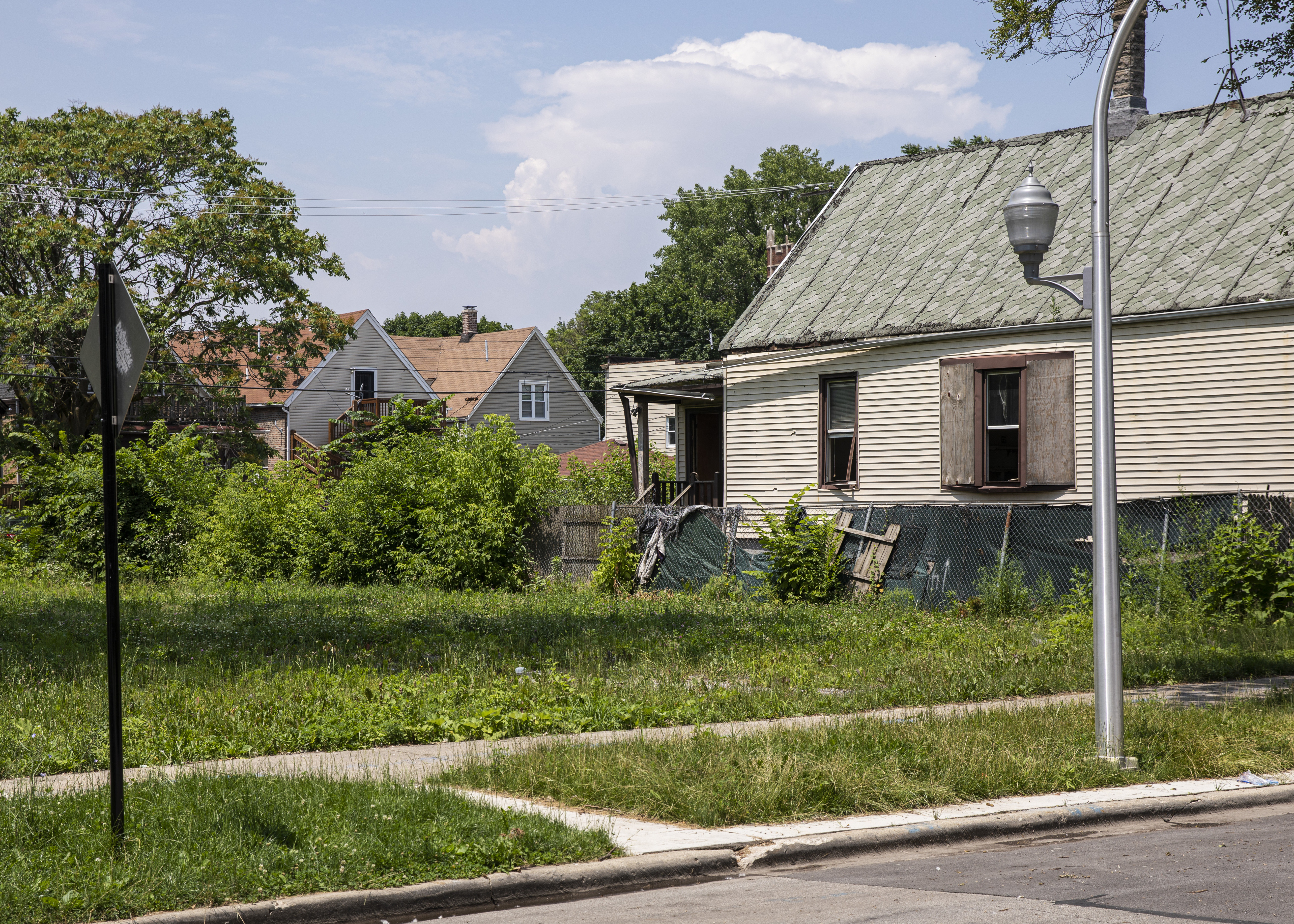 Vacant lots sit in the 6400 block of South Honore Street in Chicago's Englewood neighborhood on the South Side, Wednesday, July 3, 2019.