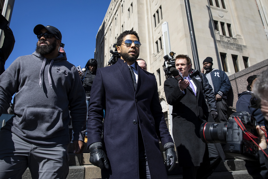 Jussie Smollett leaves court after charges were dropped.