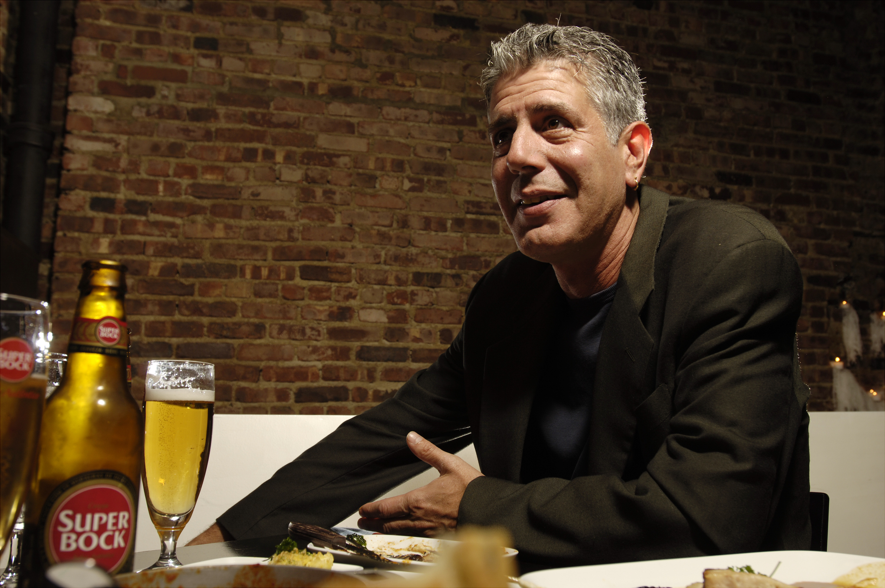 """UNITED STATES - APRIL 12: Chef Anthony Bourdain has a drink at Tintol restaurant in Times Square. Bourdain, 49, is the star of """"Anthony Bourdain: No Reservations,"""" the Travel Channel series that's half travelogue and half food show. Traveling constantly f"""
