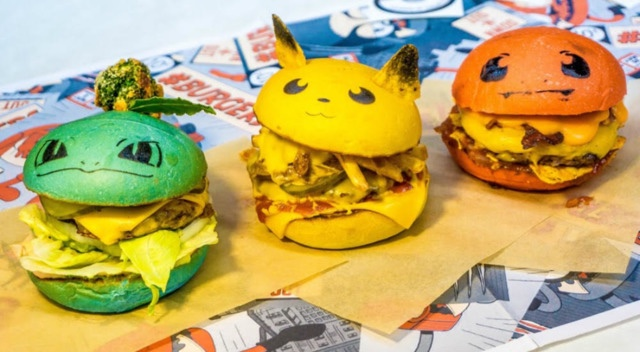 Three Pokemon character-themed burgers with green, yellow, and orange colored hamburger buns