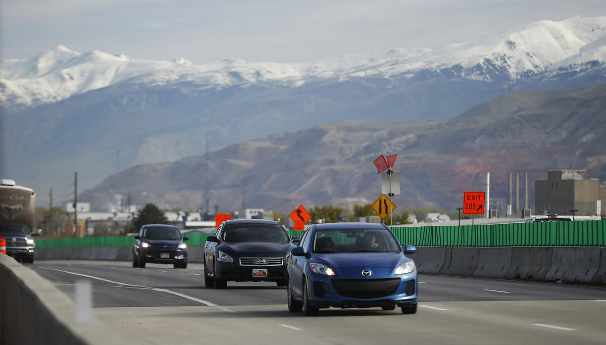 Motorists travel on I-215 as construction continues on the freeway near 2100 South in Salt Lake County on Wednesday, April 5, 2017.
