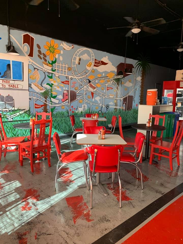 A view inside the new White Center Biscuit Bitch, with a colorful mural on one wall.