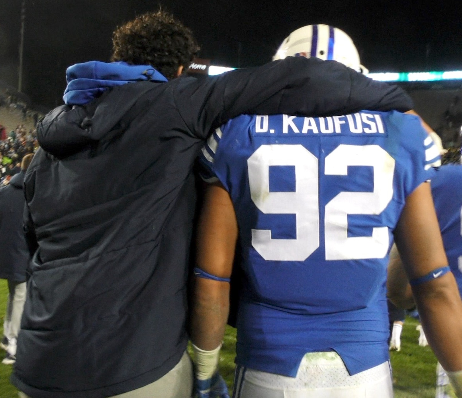 BYU defensive end Corbin Kaufusi, left, puts him arm around his brother, Devin Kaufusi, following the Cougars' 45-10 win over New Mexico State on Saturday, Nov. 17, 2018 at LaVell Edwards Stadium in the team's home finale.