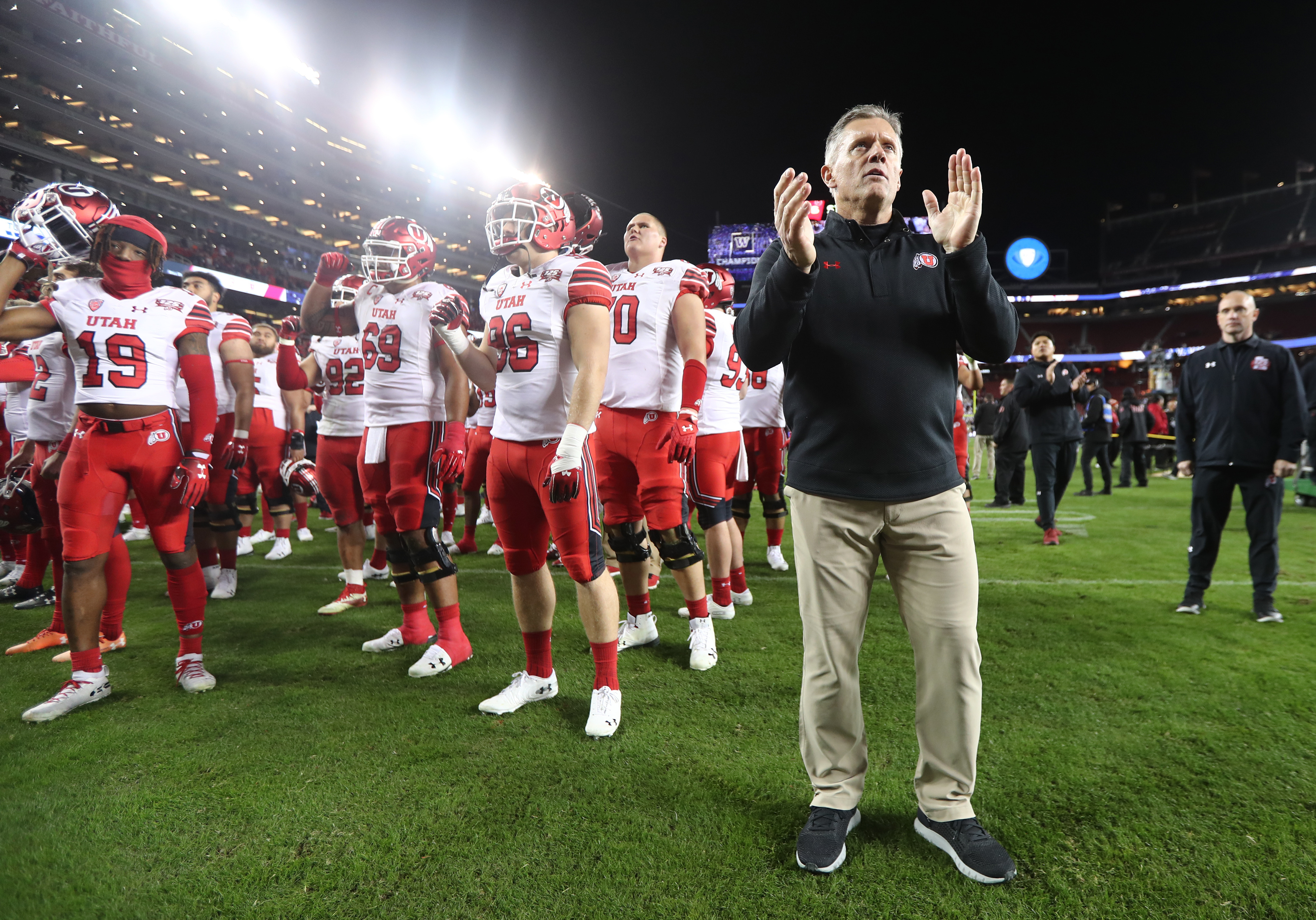 Utah Utes head coach Kyle Whittingham joins his team as they acknowledge their fans after the game as Utah falls 10-3 to Washington in the Pac-12 championship game at Levi's Stadium in Santa Clara on Friday, Nov. 30, 2018.