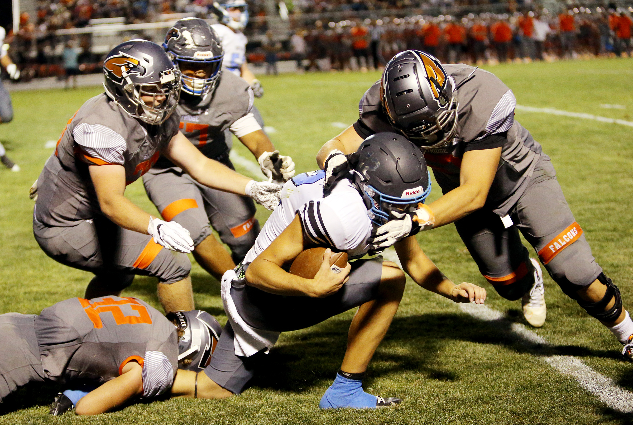 Skyridge's defense gangs up to bring down Sky View's Mason Falslev as they play in a high school football game in Lehi on Friday, Aug. 23, 2019. Skyridge won 18-10.