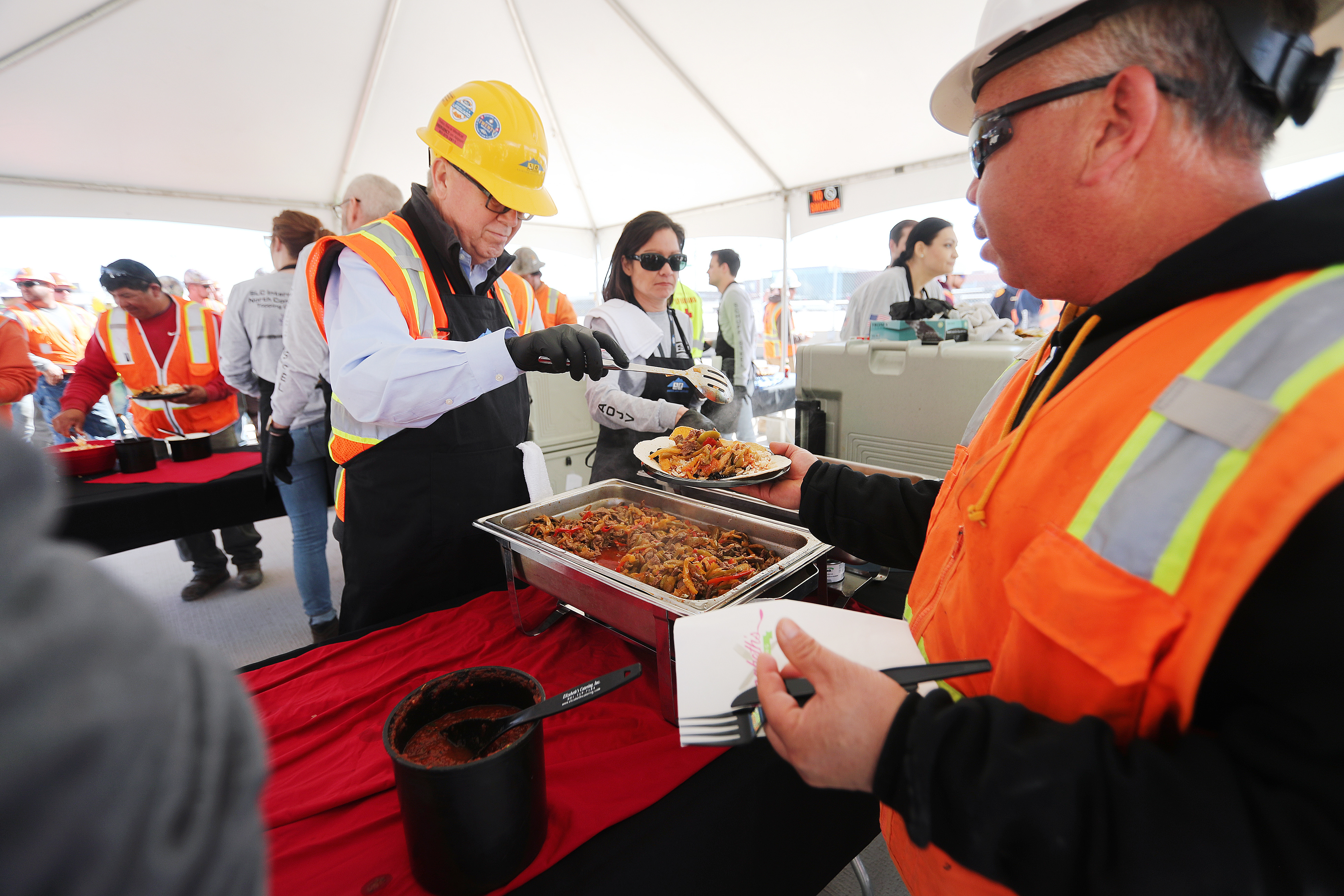 Workers on the Salt Lake City International Airport expansion project are treated to lunch following a topping-off ceremony in which the final beam was placed on the north concourse on Tuesday, March 19, 2019.